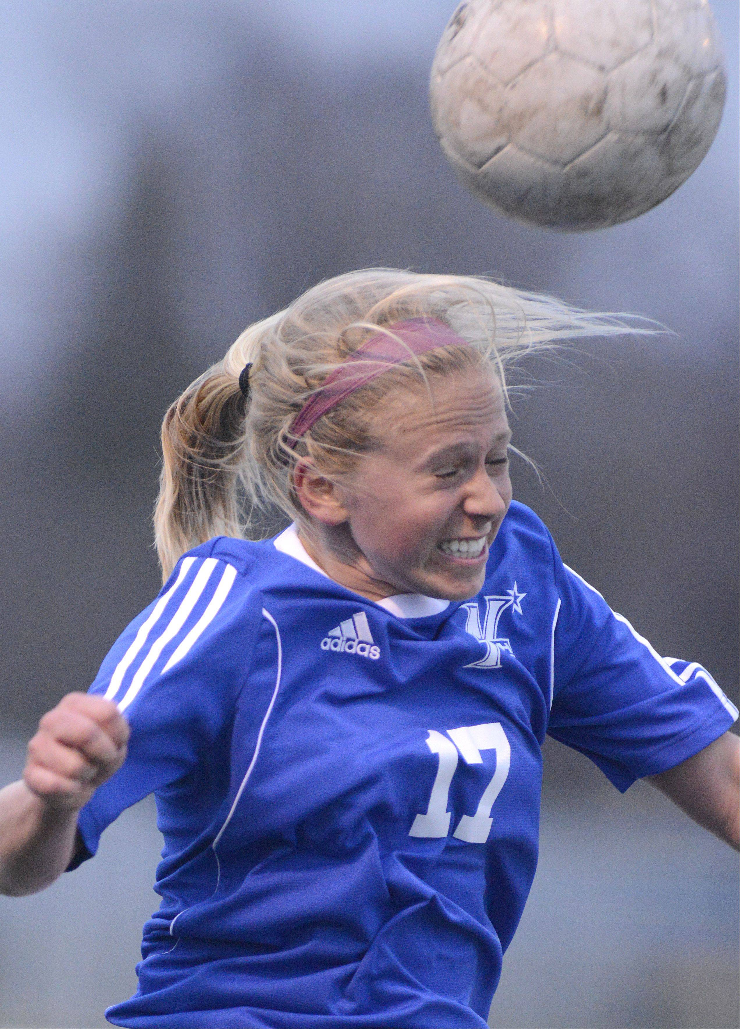 St. Charles North's Kelly Manski heads the ball in the first half on Tuesday, April 9.