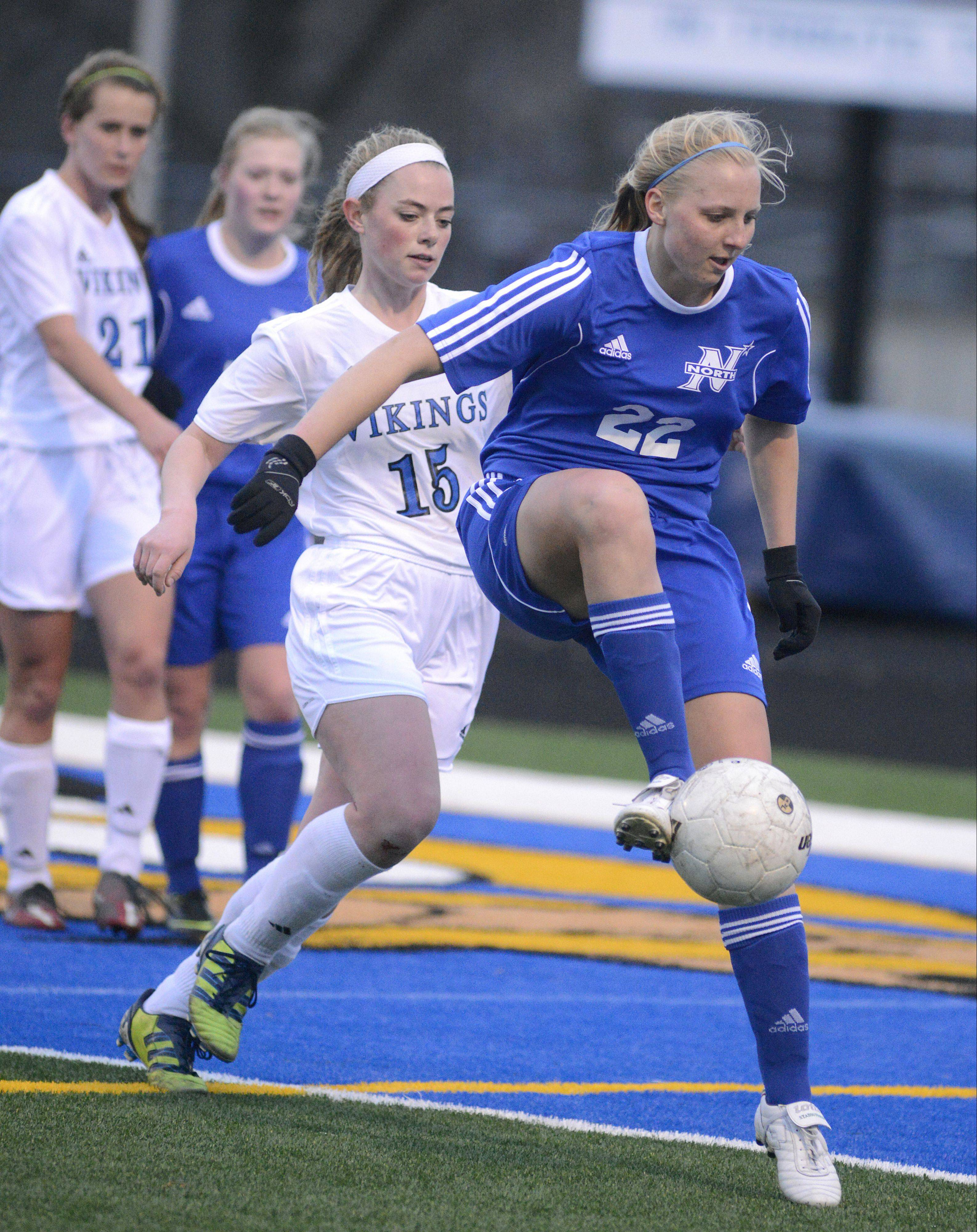 St. Charles North's Sophie Pohl receives and controls the ball before Geneva's Annie Waldoch can get to it Tuesday in Geneva.