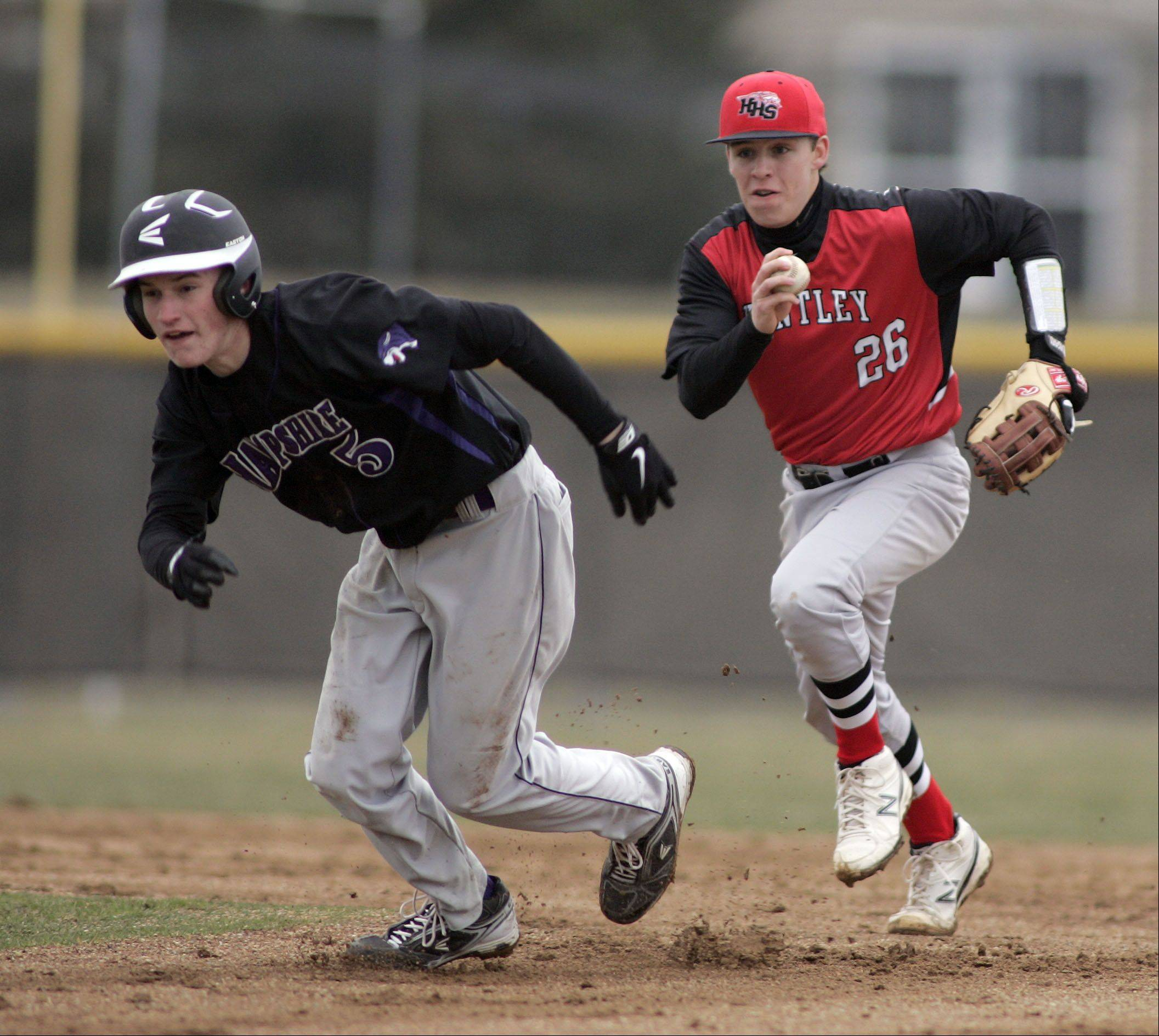 Huntley's Matt Sullivan rushes to put the tag on Hampshire's Brandon Bowen during Hampshire at Huntley baseball Tuesday. Bowen was called out on the stolen base attempt.