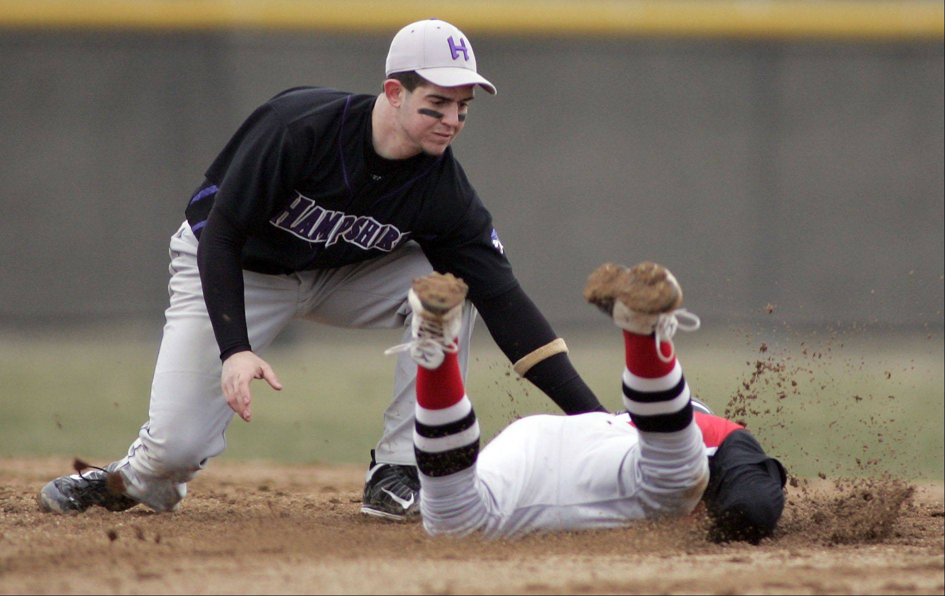 Hampshire's Michael Laramie puts the tag on Huntley's Jake Wagner on his slide into second base during Hampshire at Huntley baseball Tuesday.