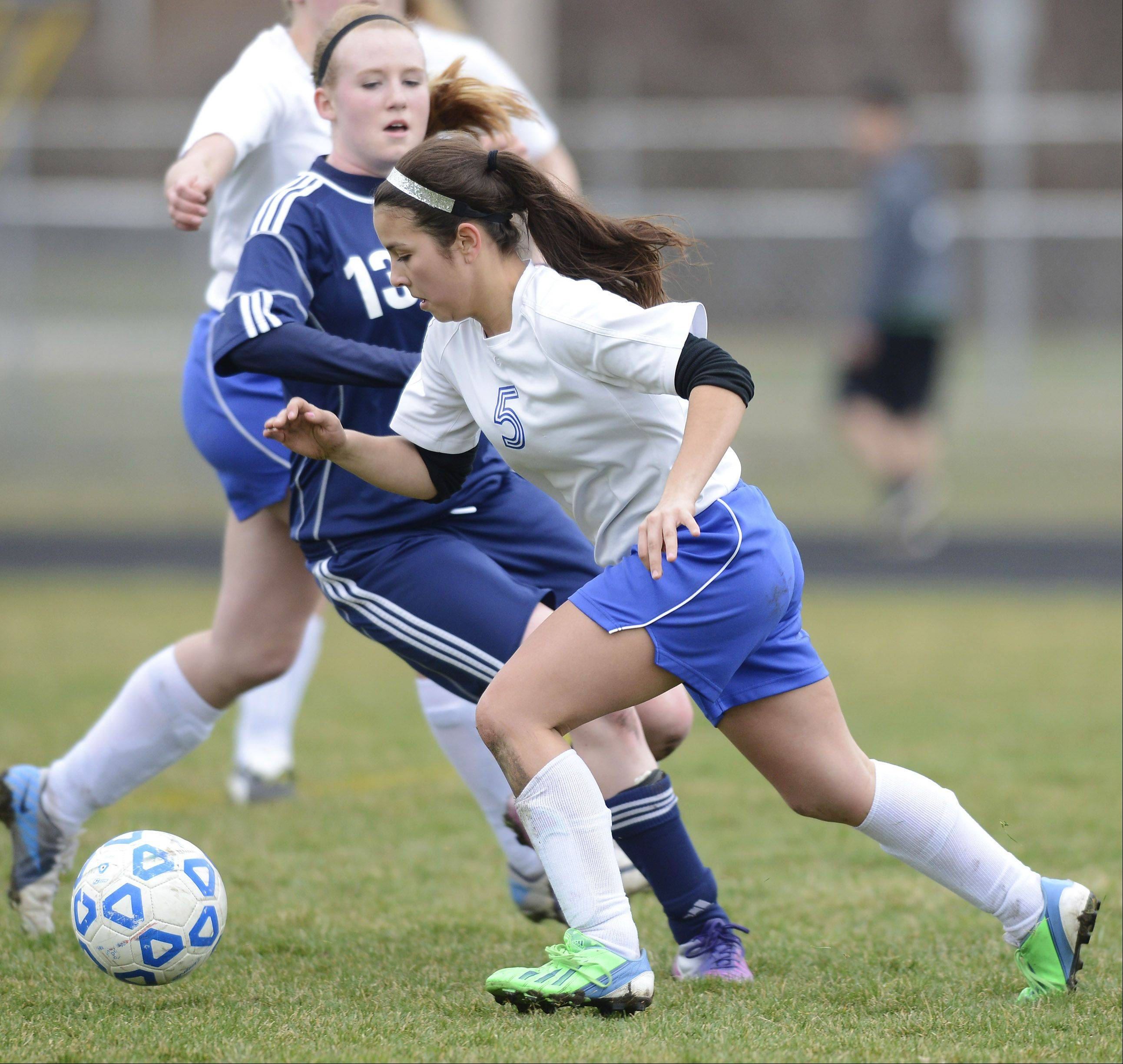 Christian Liberty's Maddie Bennett, front, tries to make a move past Harvest Christian's Morgan Lockwood during Tuesday's game in Arlington Heights.