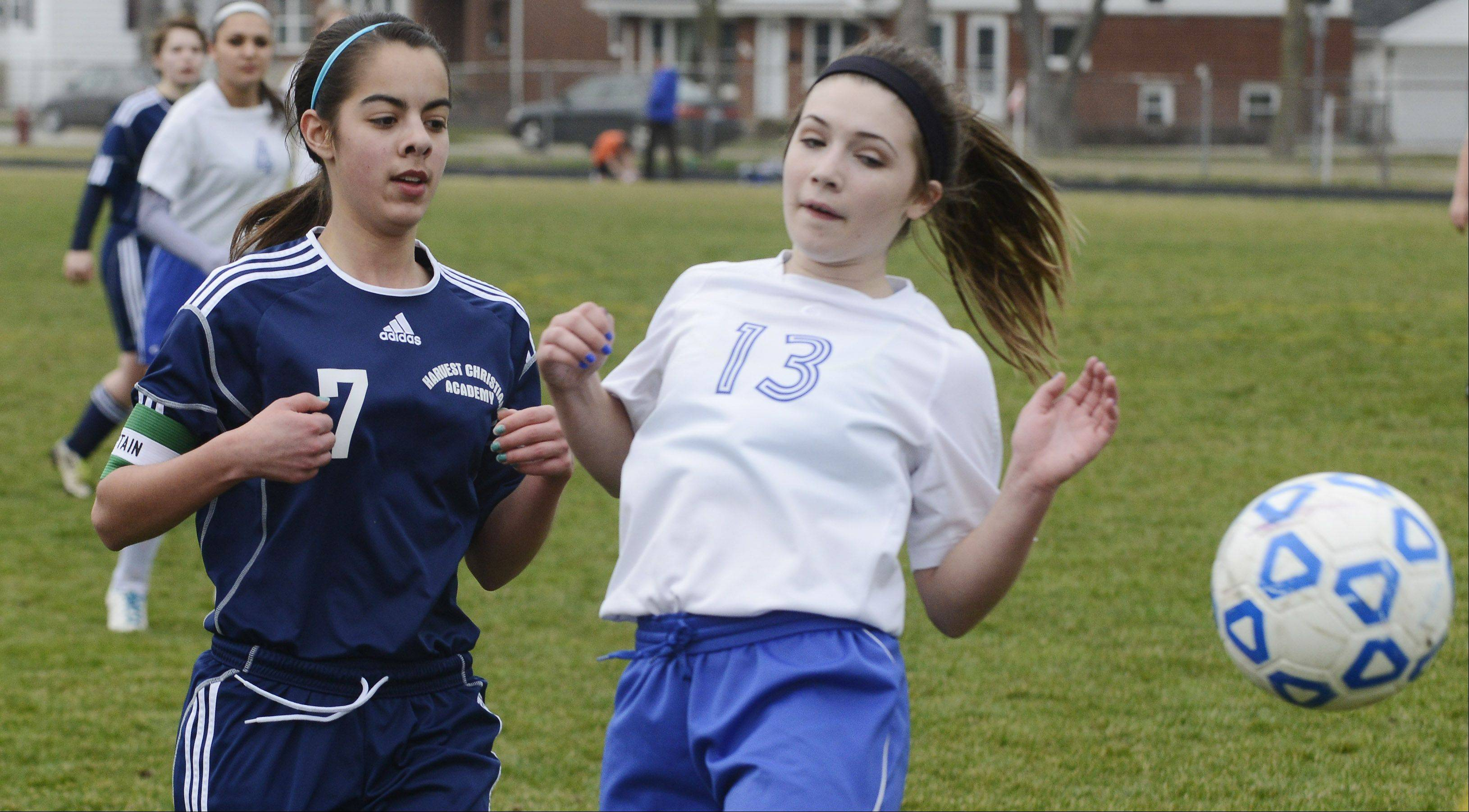 Harvest Christian's Brittany Salazar, left, directs the ball past Christian Liberty's Carly Adelsperger during Tuesday's game in Arlington Heights.