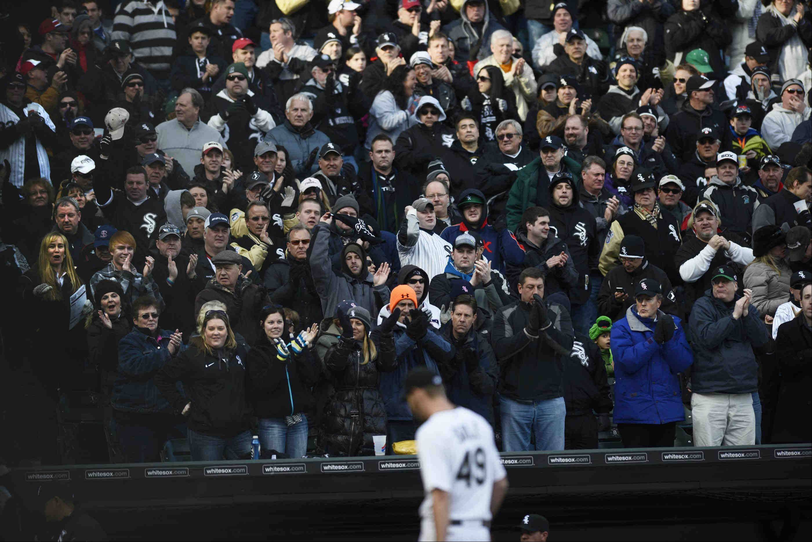 John Starks/jstarks@dailyherald.comThe crowd reacts as Chicago White Sox starting pitcher Chris Sale leaves in the eighth inning with a 1-0 lead against the Kansas City Royals in the 2013 season opener at US Cellular Field in Chicago.