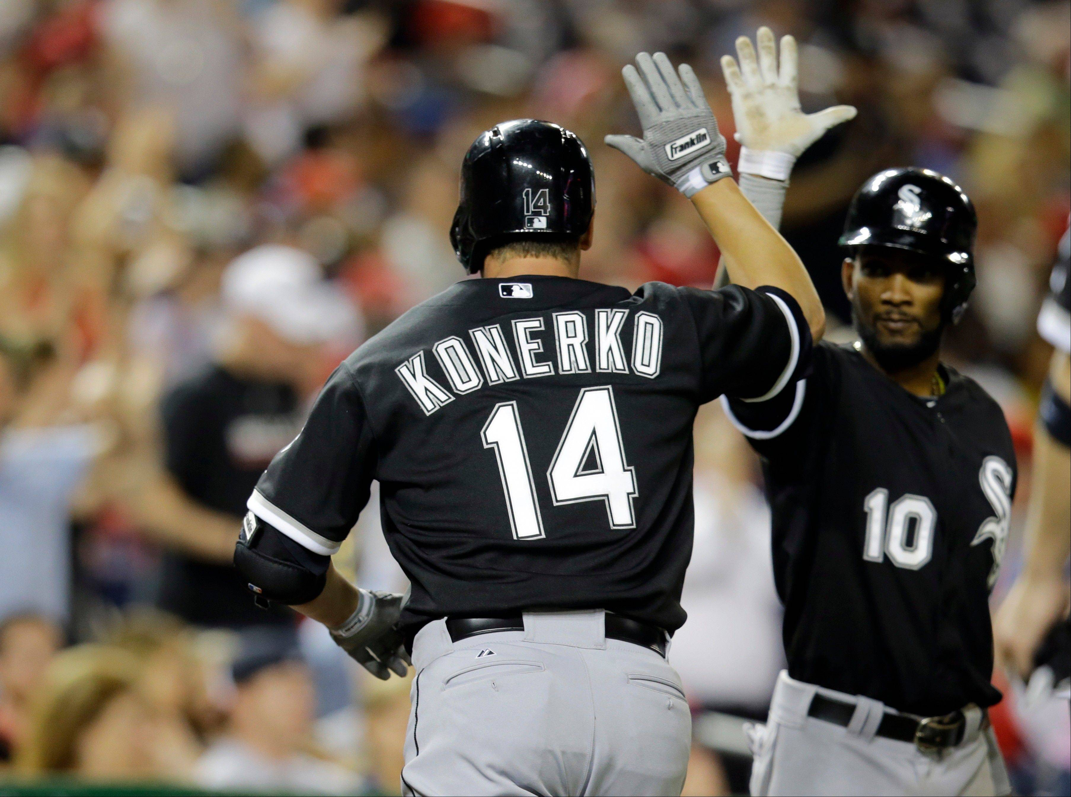 The White Sox' Paul Konerko celebrates with shortstop Alexei Ramirez (10) after his 3-run homer in the seventh inning Tuesday against the Nationals.