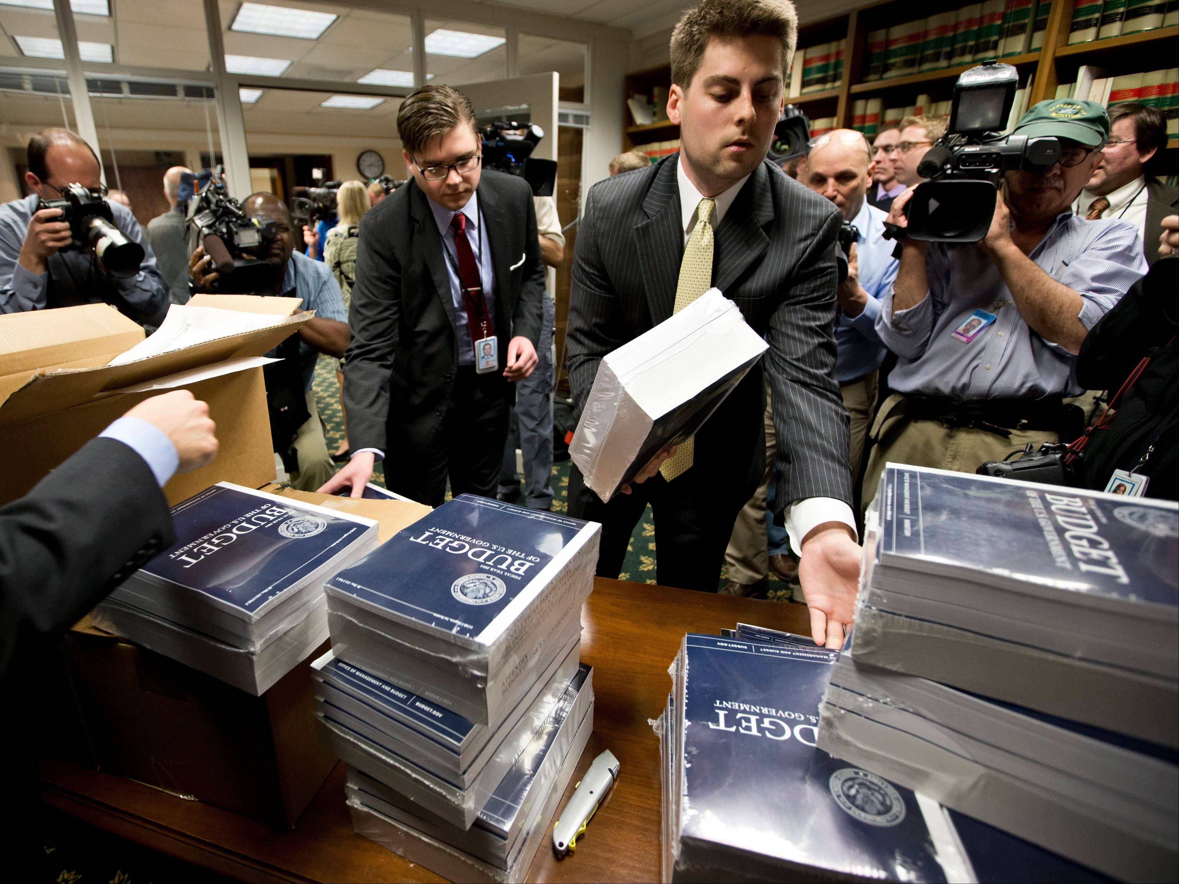 Copies of President Barack Obama's budget plan for fiscal year 2014 are distributed to Senate staff on Capitol Hill Wednesday.