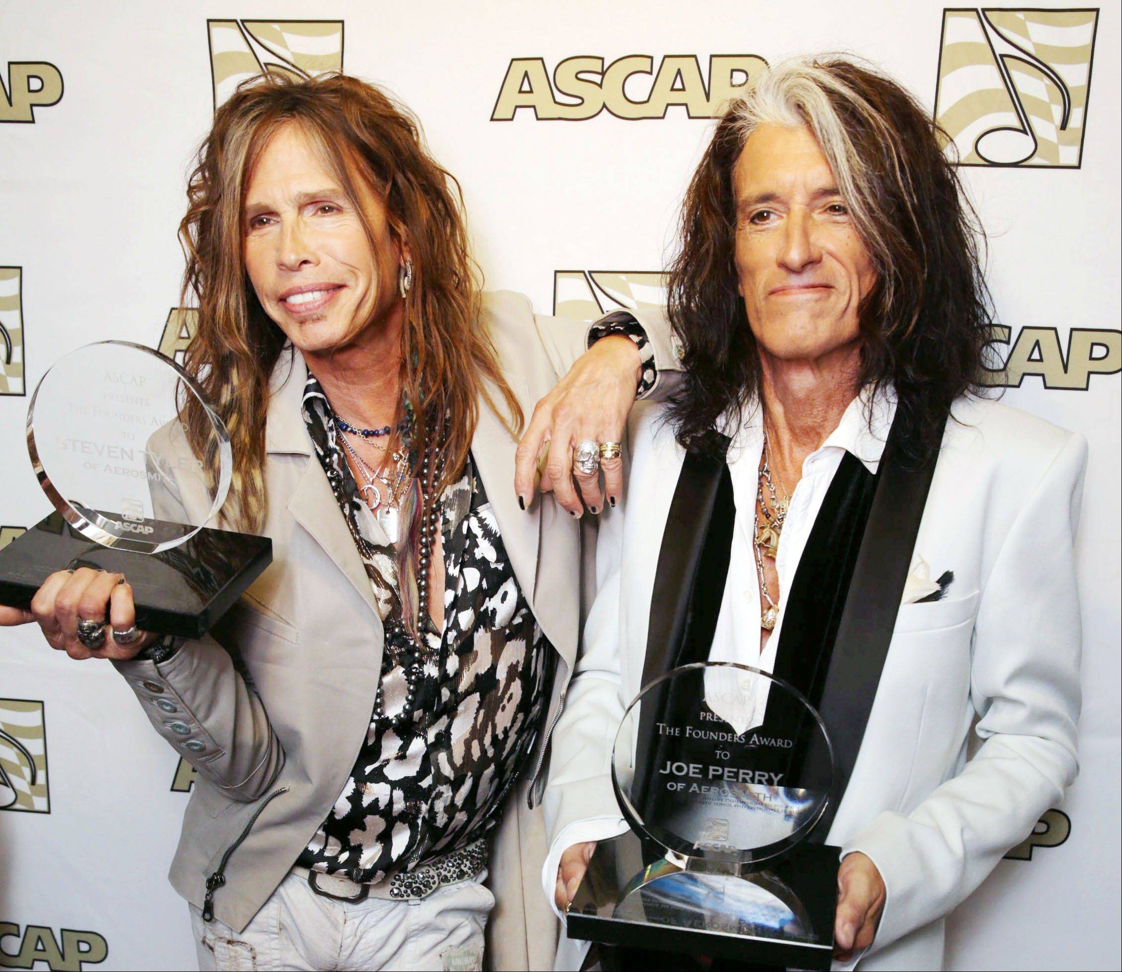 Steven Tyler, left, and Joe Perry, recipients of the ASCAP Founders Award, pose with their awards at the ASCAP Press Conference held at the Sunset Marquis, in Los Angeles. Tyler and Perry will be honored with the ASCAP Founders Award during ASCAP's 30th annual Pop Music Awards at a gala on April 17 in Los Angeles.