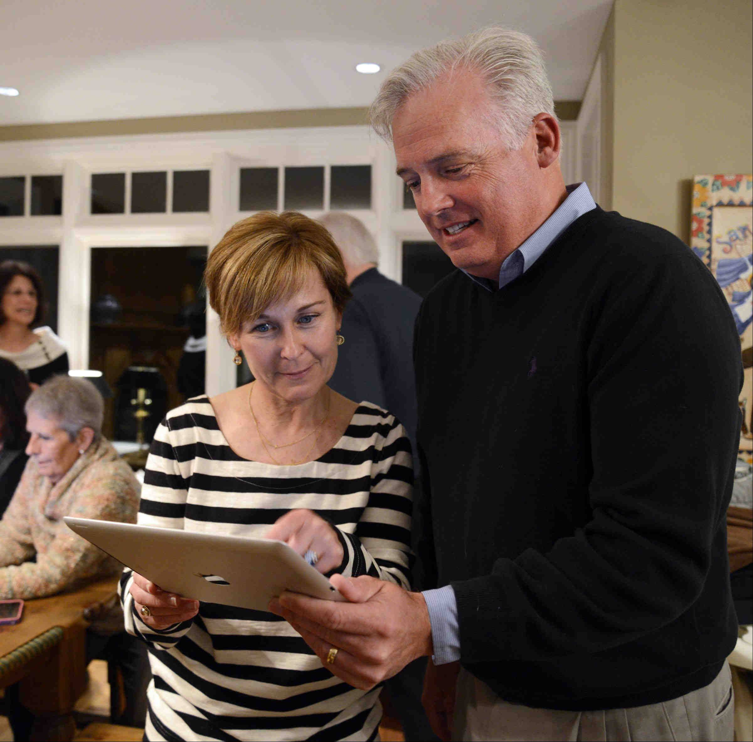 Barrington Hills Village President-elect Martin McLaughlin looks over results Tuesday at his election night party with Trustee-elect Colleen Konicek Hannigan. Both won election and will be sworn into office next month.