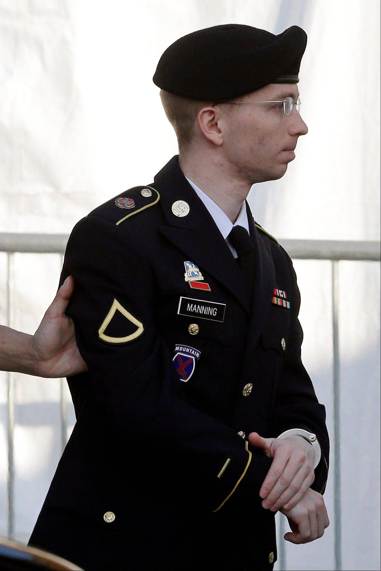 Army Pfc. Bradley Manning is escorted into a courthouse in Fort Meade, Md., Wednesday, April 10, 2013, before a pretrial military hearing. Manning, who is charged with causing hundreds of thousands of classified documents to be published on the secret-sharing website WikiLeaks, is scheduled to face a court martial in June.