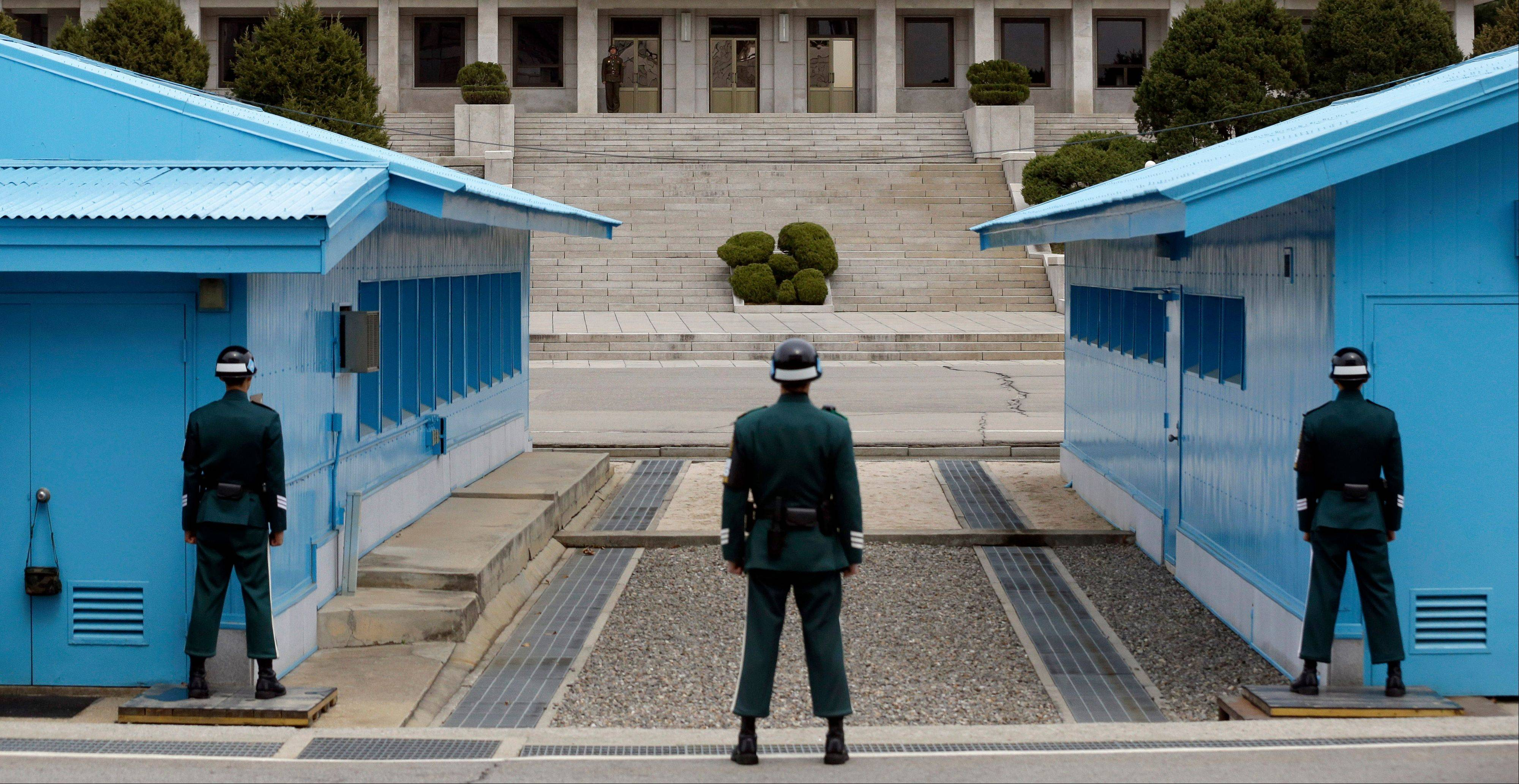 A North Korean soldier, center top, looks at the southern side as South Korean soldiers stand guard at the border village of Panmunjom, which has separated the two Koreas since the Korean Wa. The prospect of a North Korean missile launch is �considerably high,� South Korea�s foreign minister told lawmakers Wednesday as Pyongyang prepared to mark the April 15 birthday of its founder, historically a time when it seeks to draw the world�s attention with dramatic displays of military power.