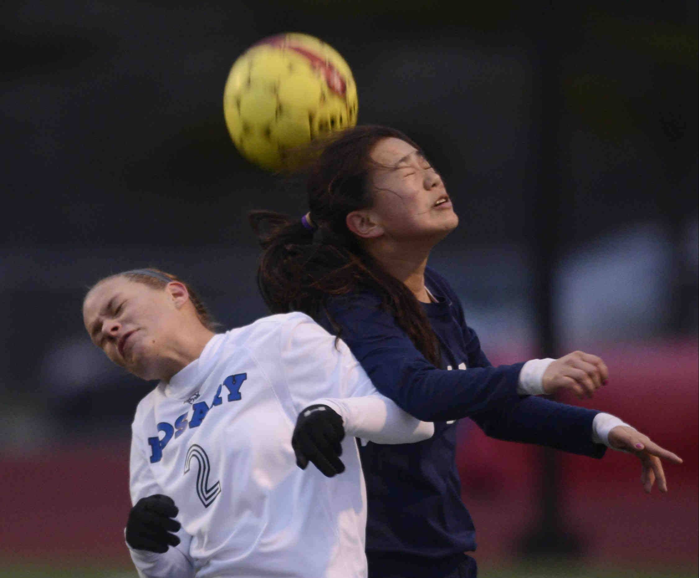 Rosary�s Molly Piech and West Aurora�s Carli Hix collide as they compete for a header Wednesday in Aurora.