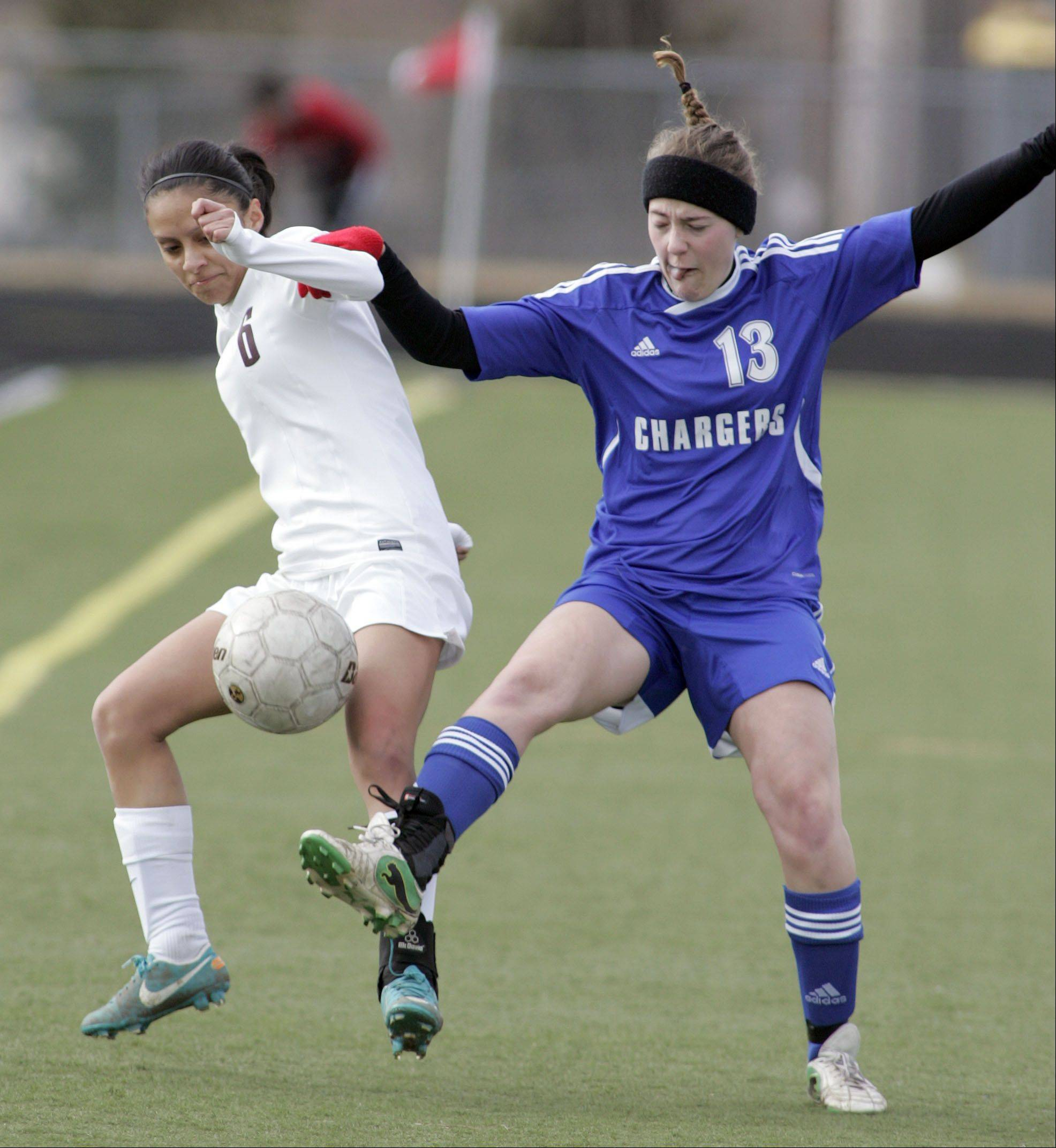 Elgin�s Daisy Gomez (6) battles Dundee-Crown�s Cori Schrade during girls soccer action in the South Elgin Spring Break tournament at Millennium Field in Streamwood earlier this season.