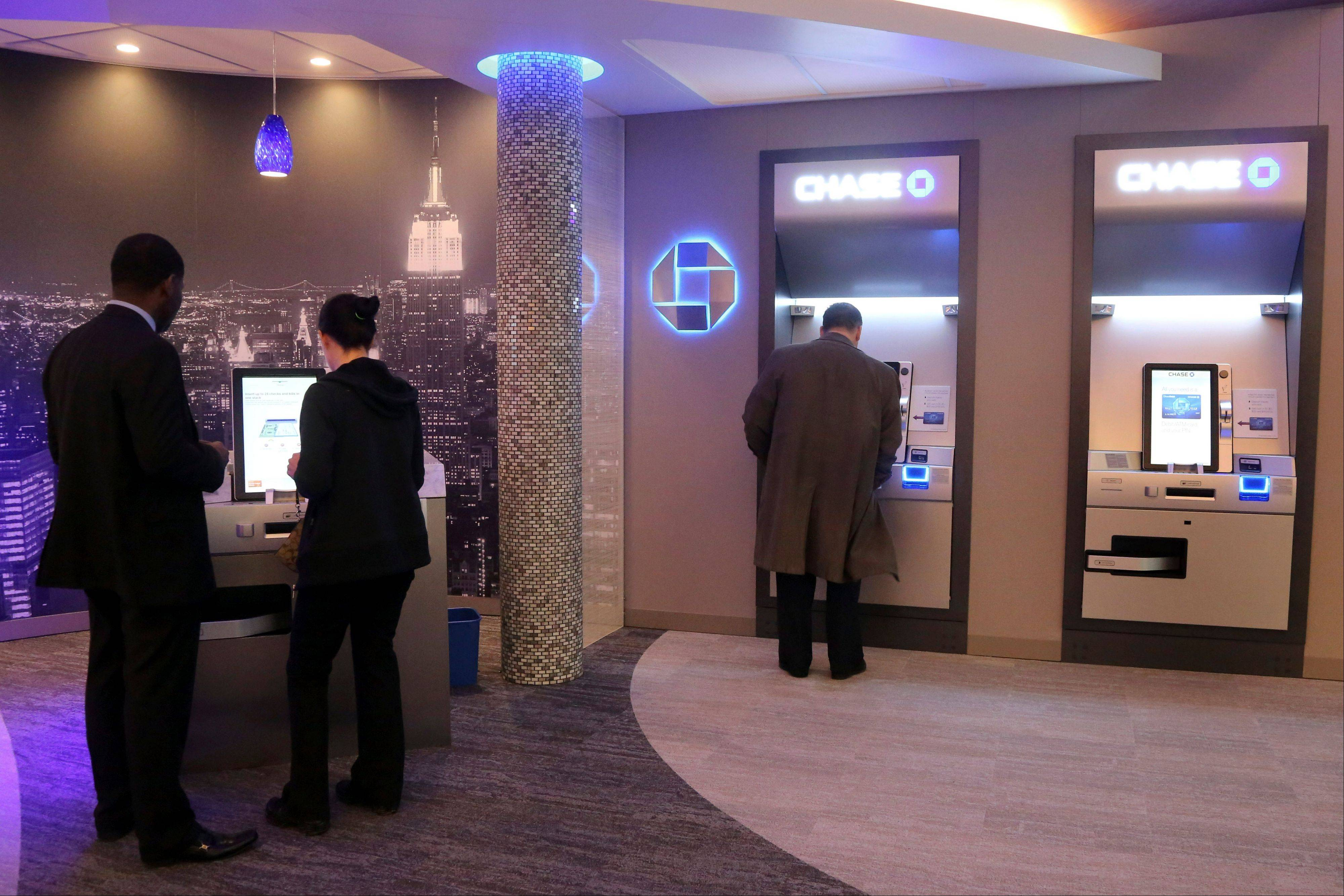 "People use the Self Service Banking Kiosks at a JPMorgan Chase lobby in New York. JPMorgan Chase executives are touting what they call their ""Branch of the Future,"" a place where ATMs distribute exact change, machines count cash so tellers don't have to."