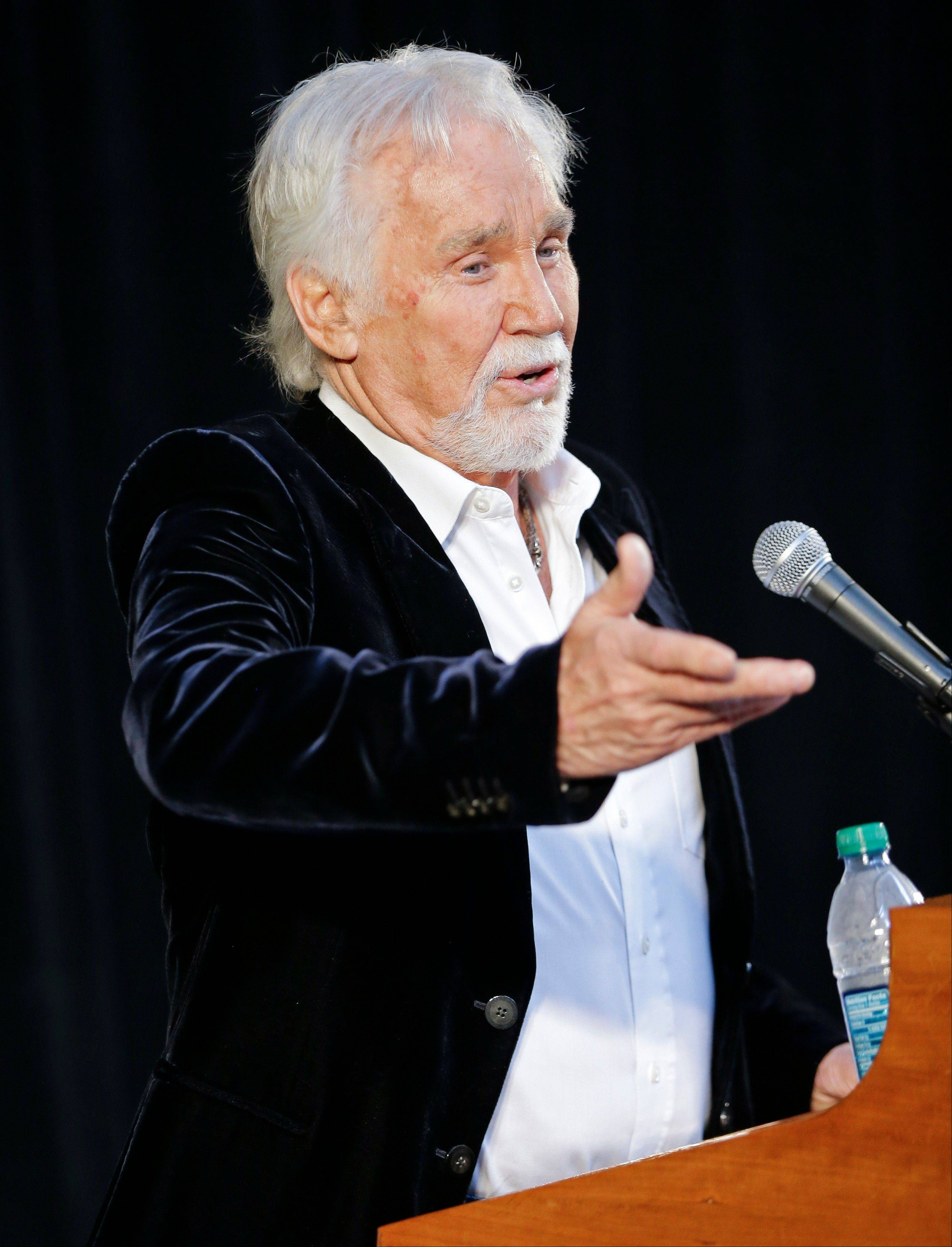 Kenny Rogers speaks on Wednesday in Nashville during the announcement that he will be inducted into the Country Music Hall of Fame. Rogers will be inducted with Bobby Bare and Jack Clement.