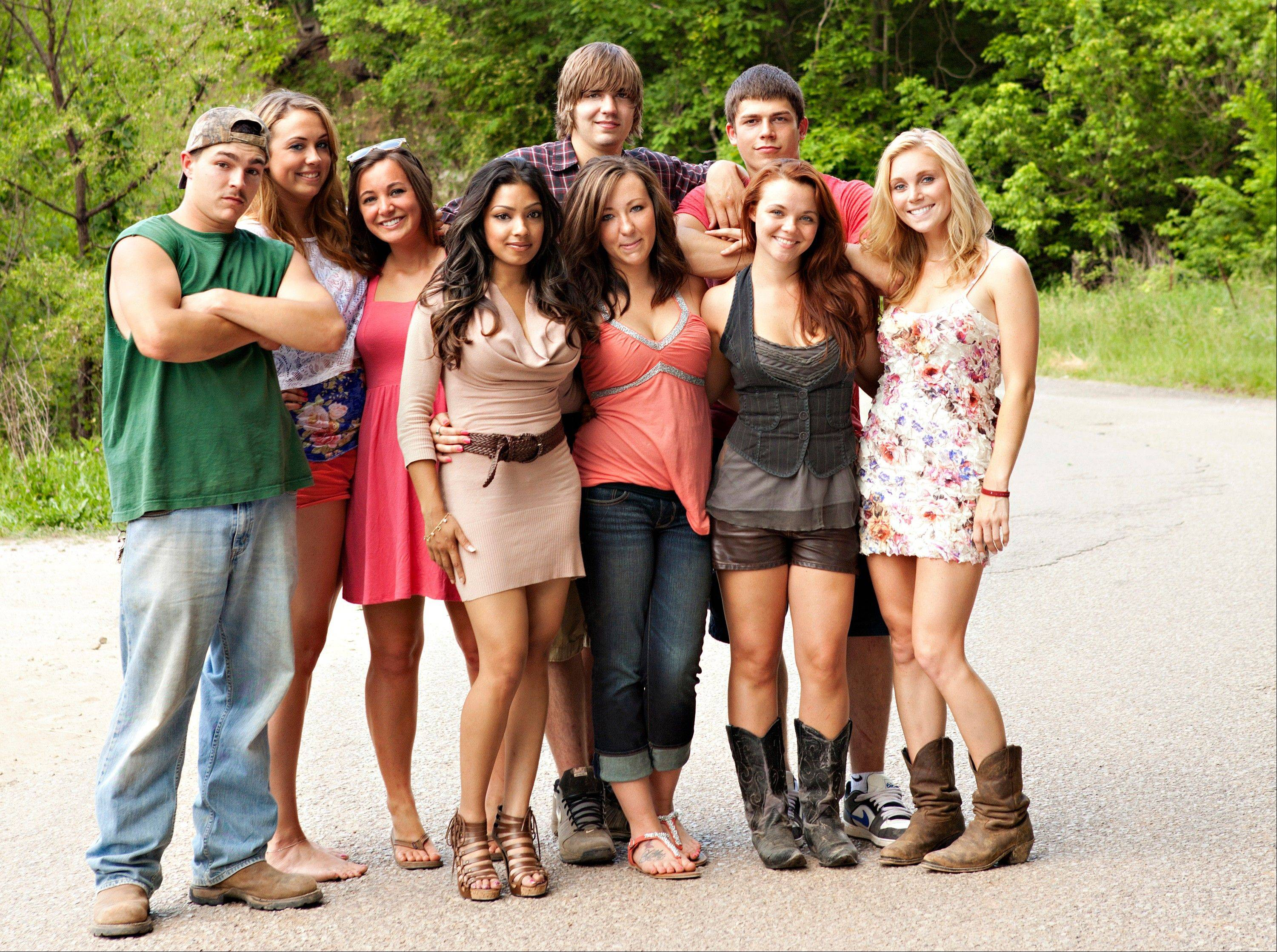 "The original cast of the reality series ""Buckwild,"" from left, included the late Shain Gandee, Anna, Katie, Salwa, Joey, background center, Ashley, Tyler, background right, Cara and Shae. MTV said Wednesday, it is canceling the West Virginia-based reality TV show."