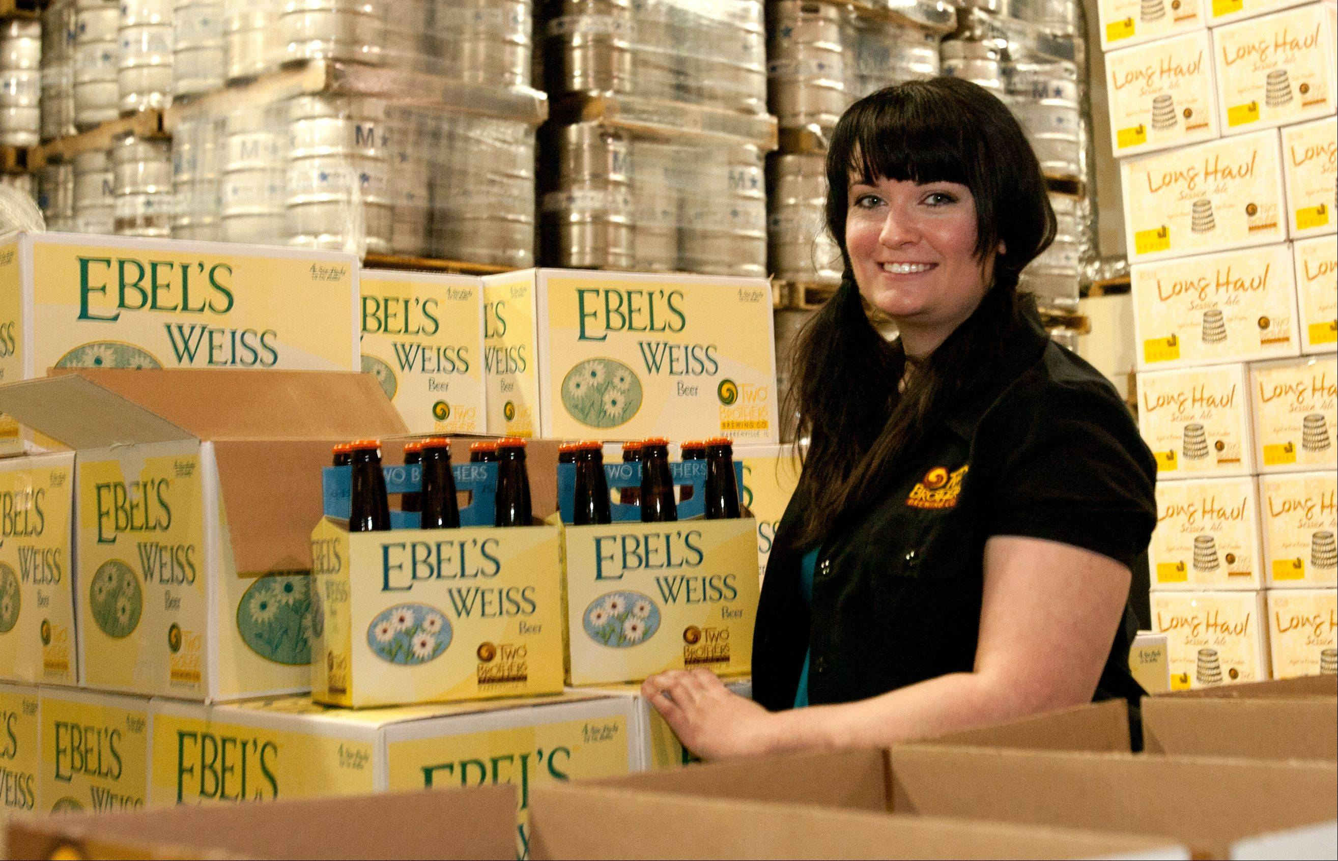 Ashleigh Arnold, brew master at the Two Brothers brewery in Warrenville, shows off the brewery's Ebel's Weiss.