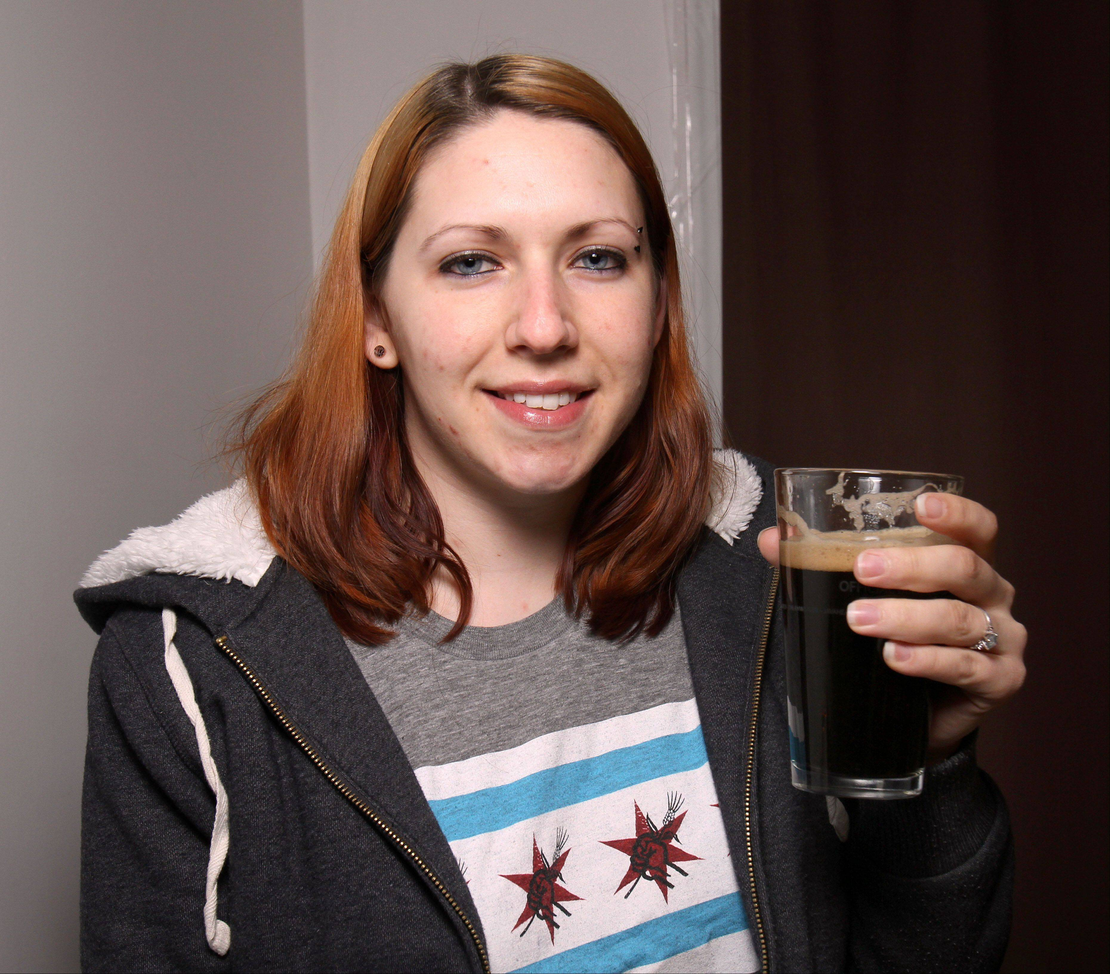 Valerie Delligatti of Round Lake Beach enjoys a pint of stout she brewed at home.