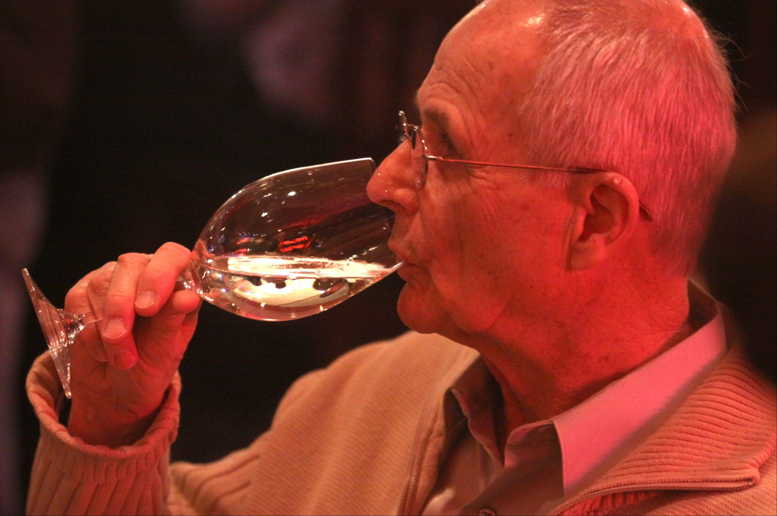Gordon Robinson, of Arlington Heights, enjoys a New Zealand Sauvignon Blanc at the Tuscan Market Wine Bar.