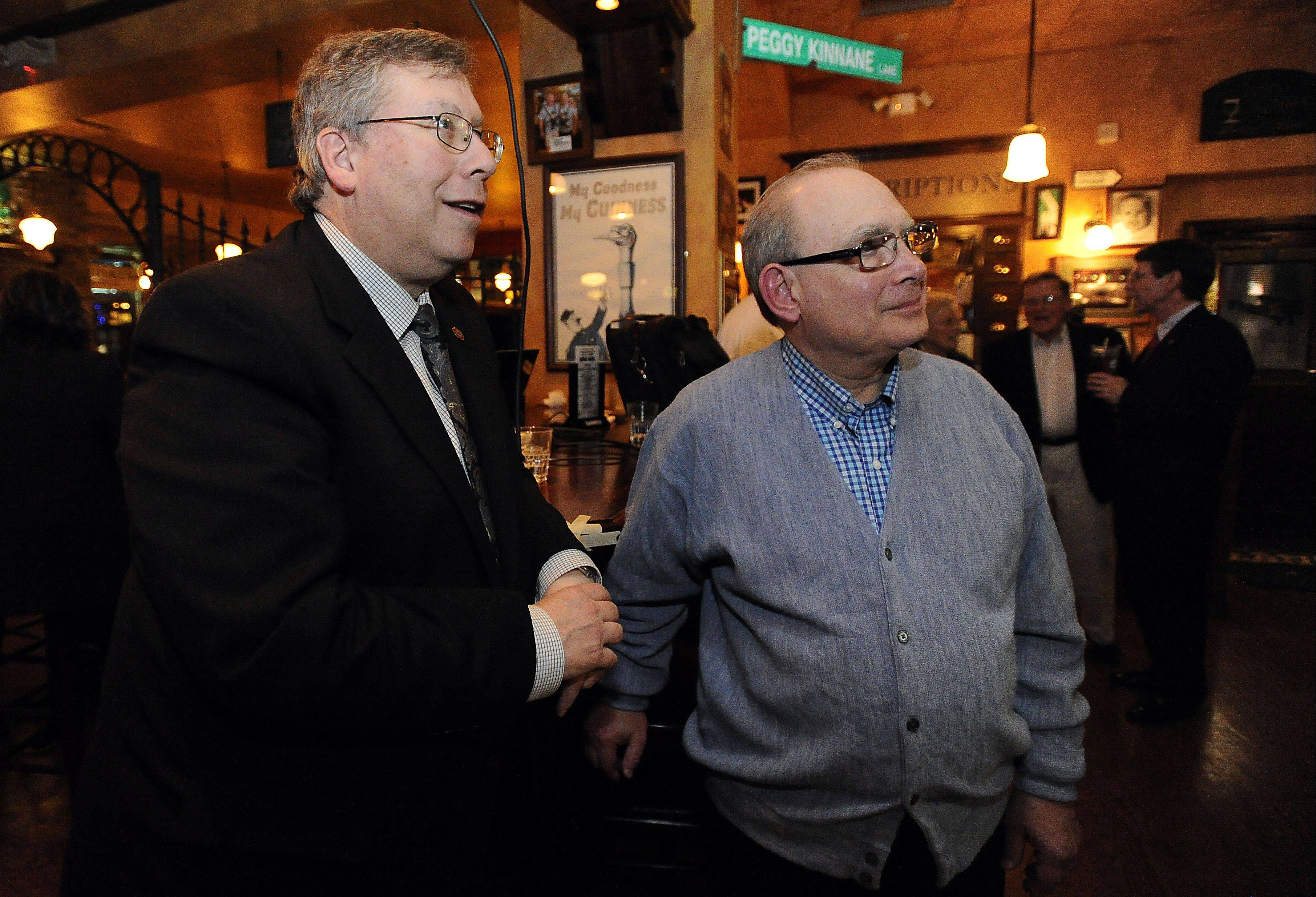 Bert Rosenberg and Norm Breyer watch the polls late Tuesday evening. Breyer and Rosenberg are waiting on absentee ballots to find out which one of them will get the board seat as currently there are only 22 votes separating them.