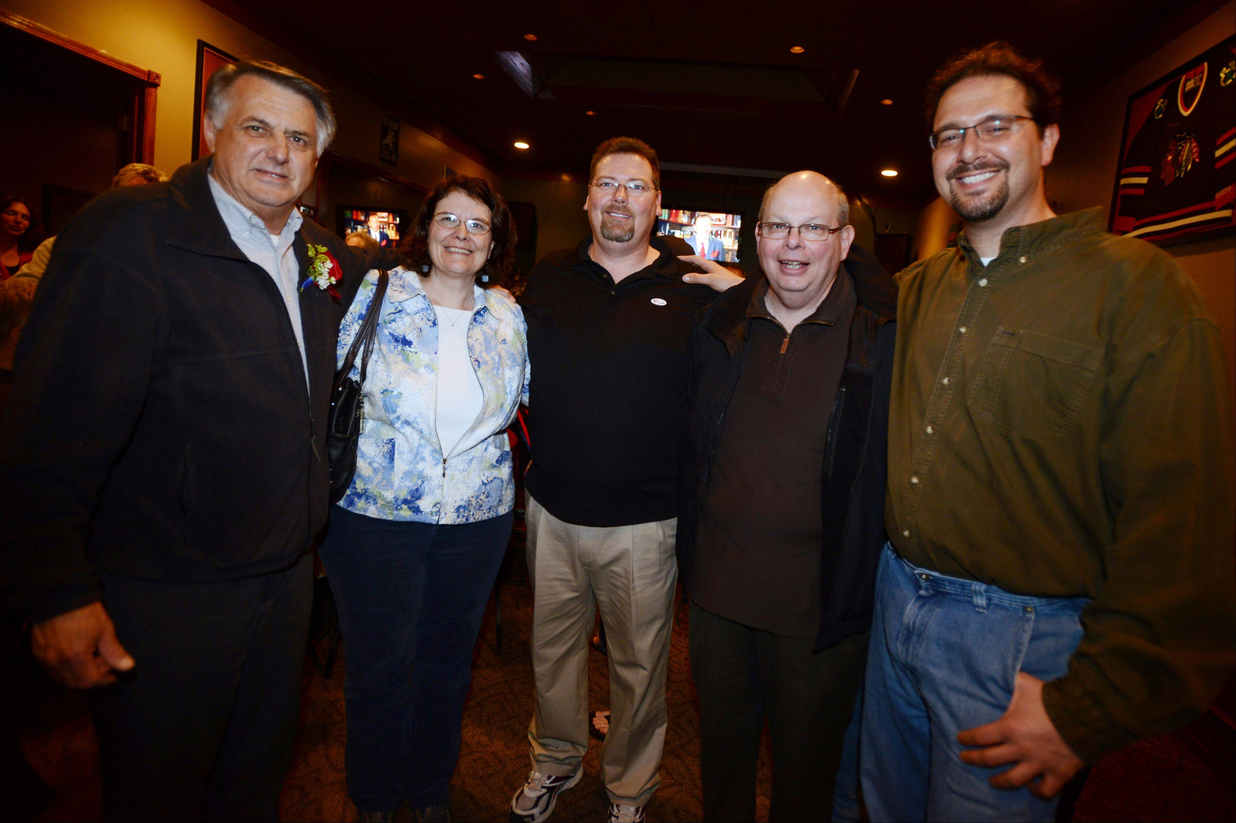 Island Lake candidates Charles Amrich, left, Teresa Ponio, Keith Johns, Tony Sciarrone and Mark Beeson celebrate their landslide victories Tuesday.