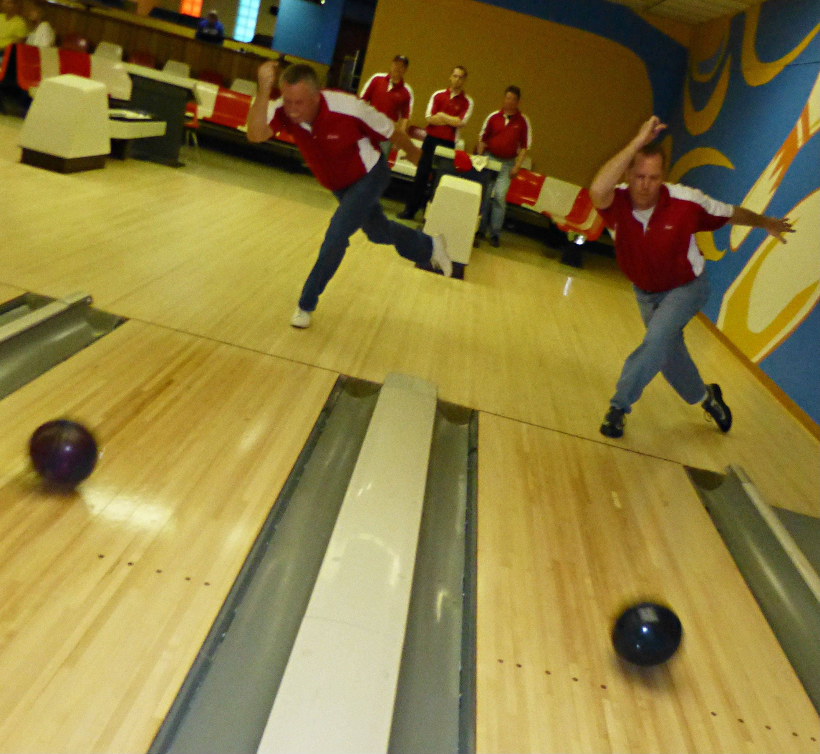 Elgin Lanes team members Larry Slack of Elgin, left and Ken Buhlman, South Elgin, practice for the Cross-Town Classic.
