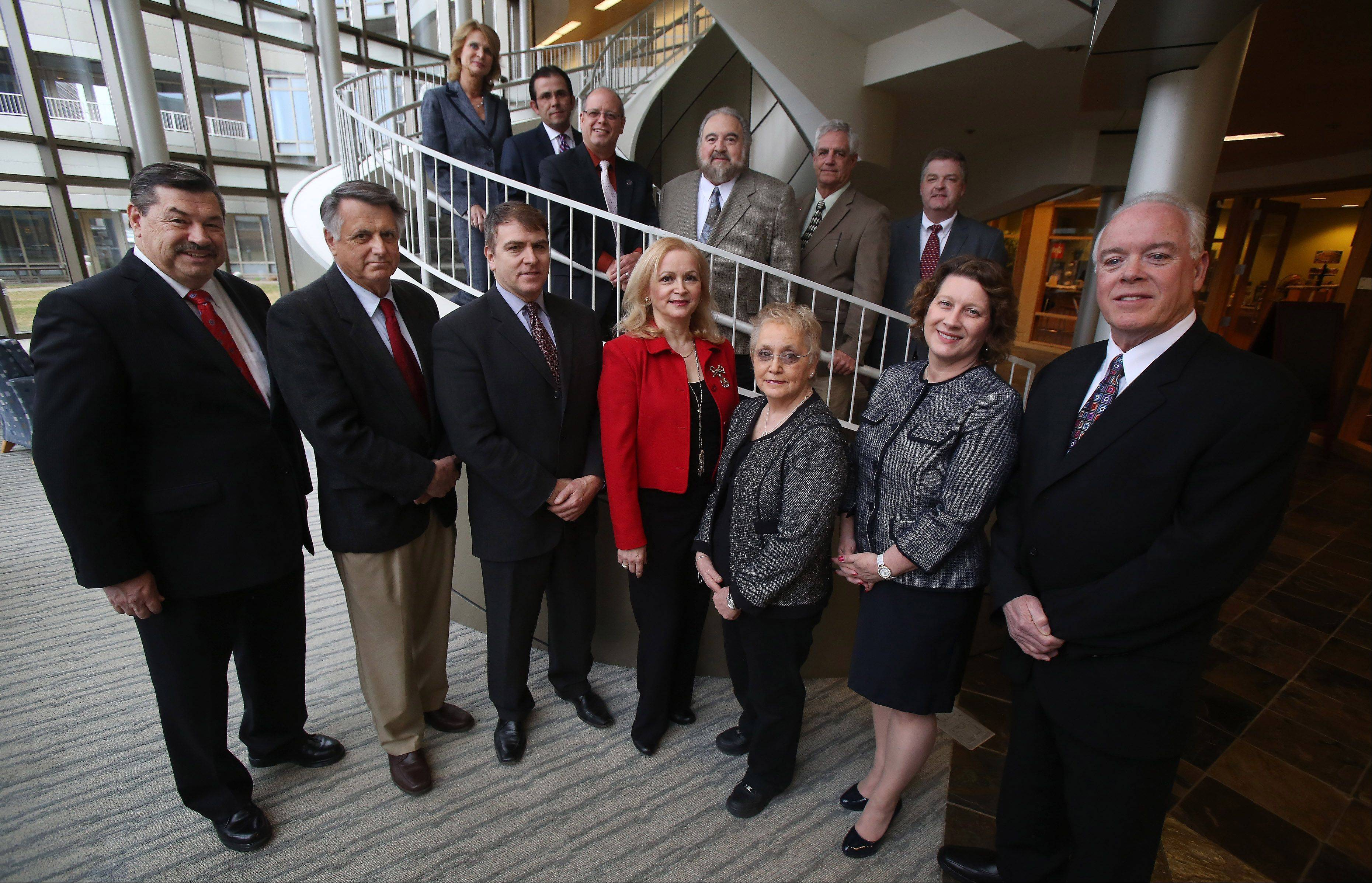 Lake County mayoral winners gather at the University Center in Grayslake a day after elections in area towns. Front left: Bernard Wysocki, Green Oaks; Charles Amrich, Island Lake; Lawrence Hanson, Antioch; Nandia Black, Kildeer; Linda Lucassen, Round Lake Park; Angie Underwood, Long Grove; and Tom Poynton, Lake Zurich. Back left: Kristina Kovarik, Gurnee; Joe Mancino, Hawthorn Woods; Rich Hill, Round Lake Beach; Frank Loffredo, Lake Villa; Donald Schmit, Fox Lake; and Steve Lentz, Mundelein.