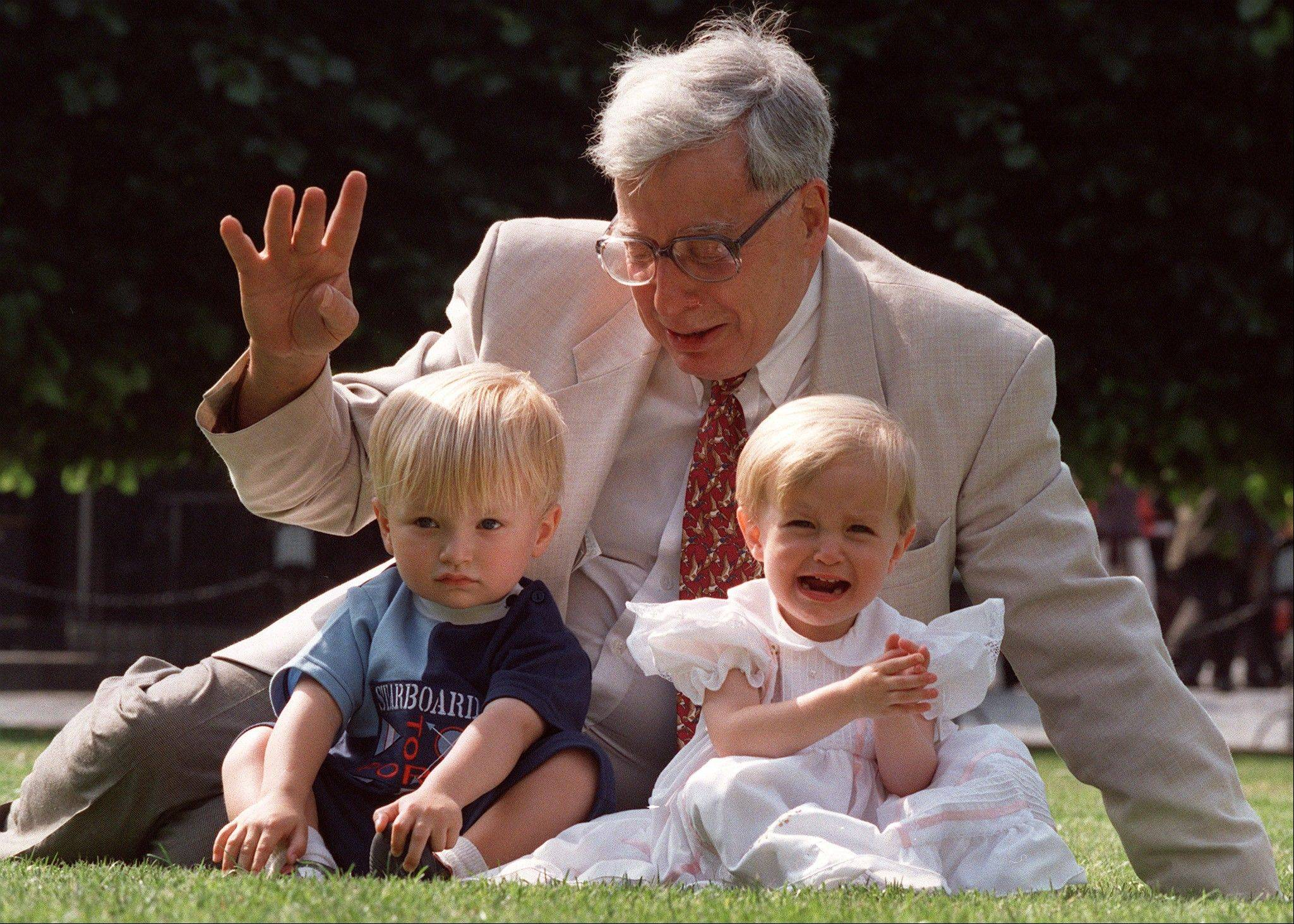 The British pioneer of IVF treatment, Professor Robert Edwards, sits with two of his 'test-tube-babies' in 1998. The Nobel Prize winner for medicine, Edwards has died at age 87.