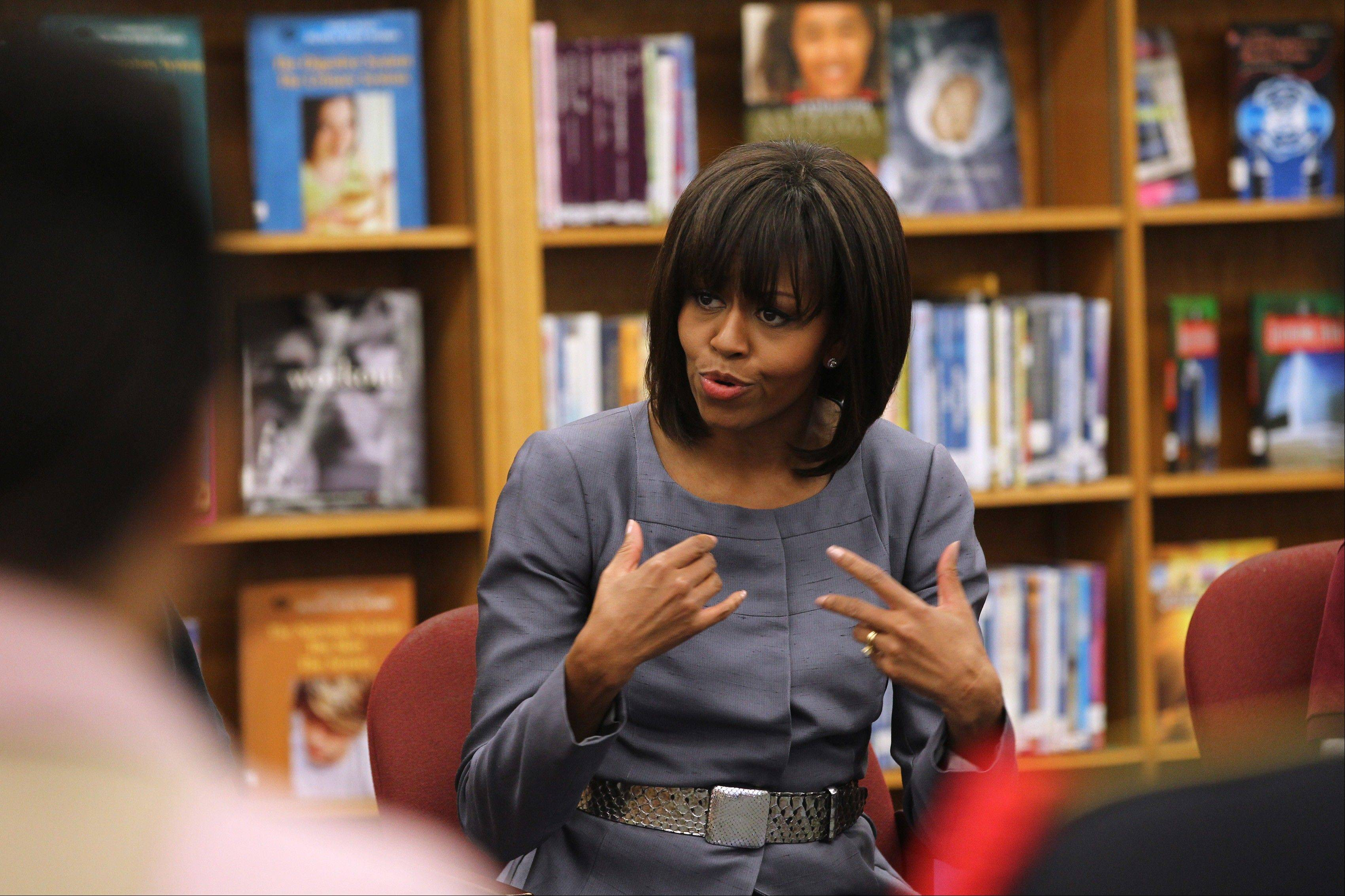 First lady Michelle Obama talks to students at Harper High School in Chicago Wednesday. She also called for more funding for community programs to help break the cycle of gun violence in a deeply personal speech in her hometown of Chicago.