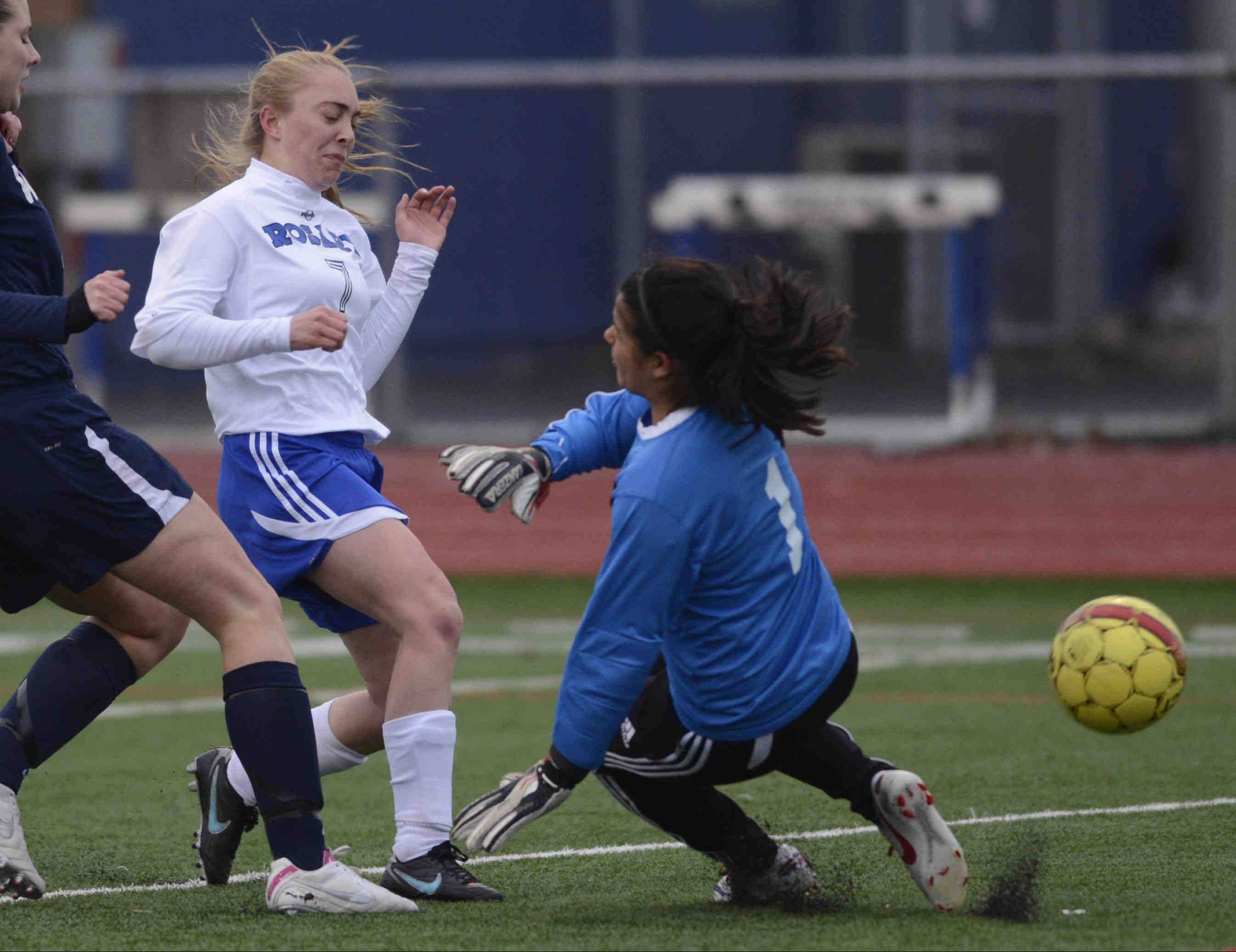 Rosary's Emily Martin gets a shot past West Aurora goalkeeper Jasmine Mejia. The ball went wide.