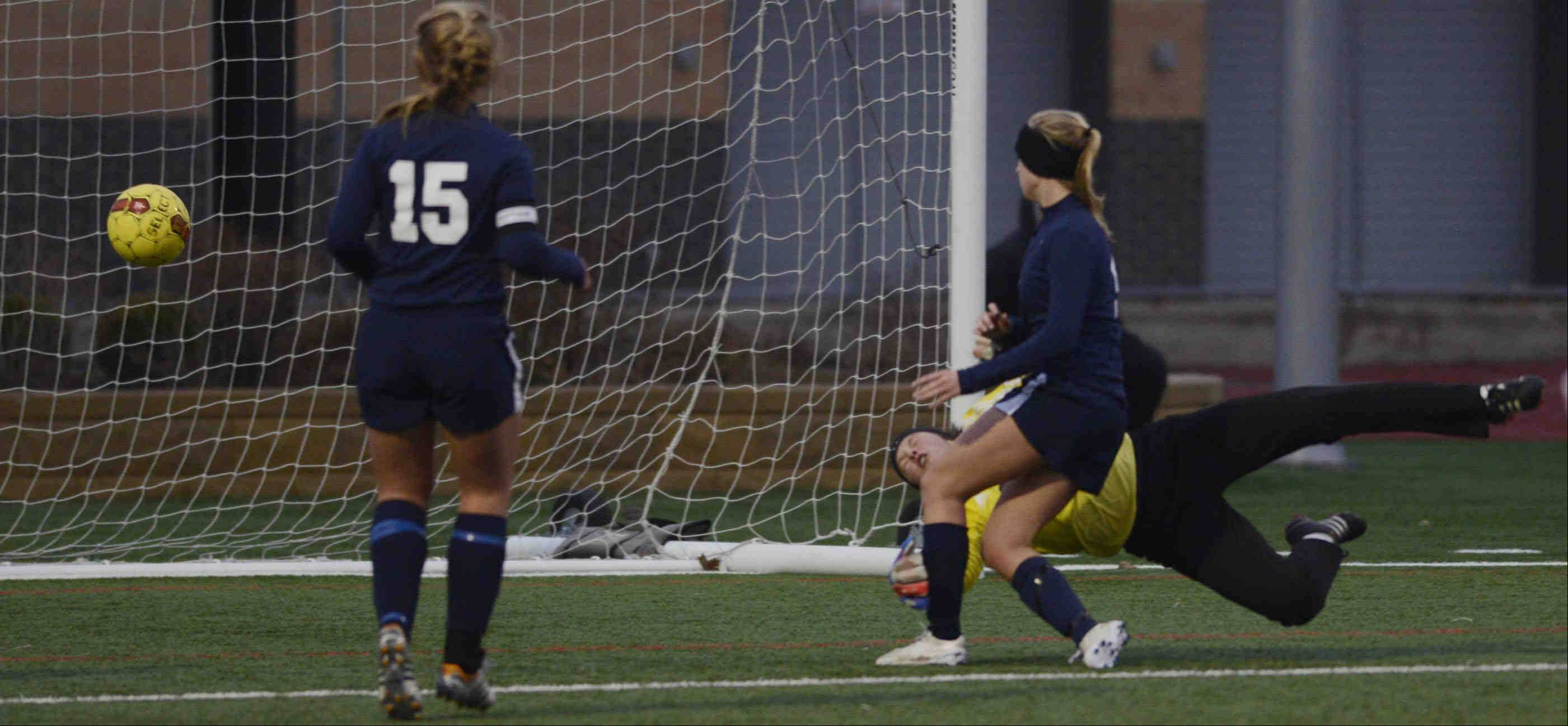 John Starks/jstarks@dailyherald.comRosary goalkeeper Lauren Frasca can't stop a shot by West Aurora's Samantha O Brien Wednesday in Aurora. West Aurora's Reilly Kulakowski watches the ball bounce into the net.