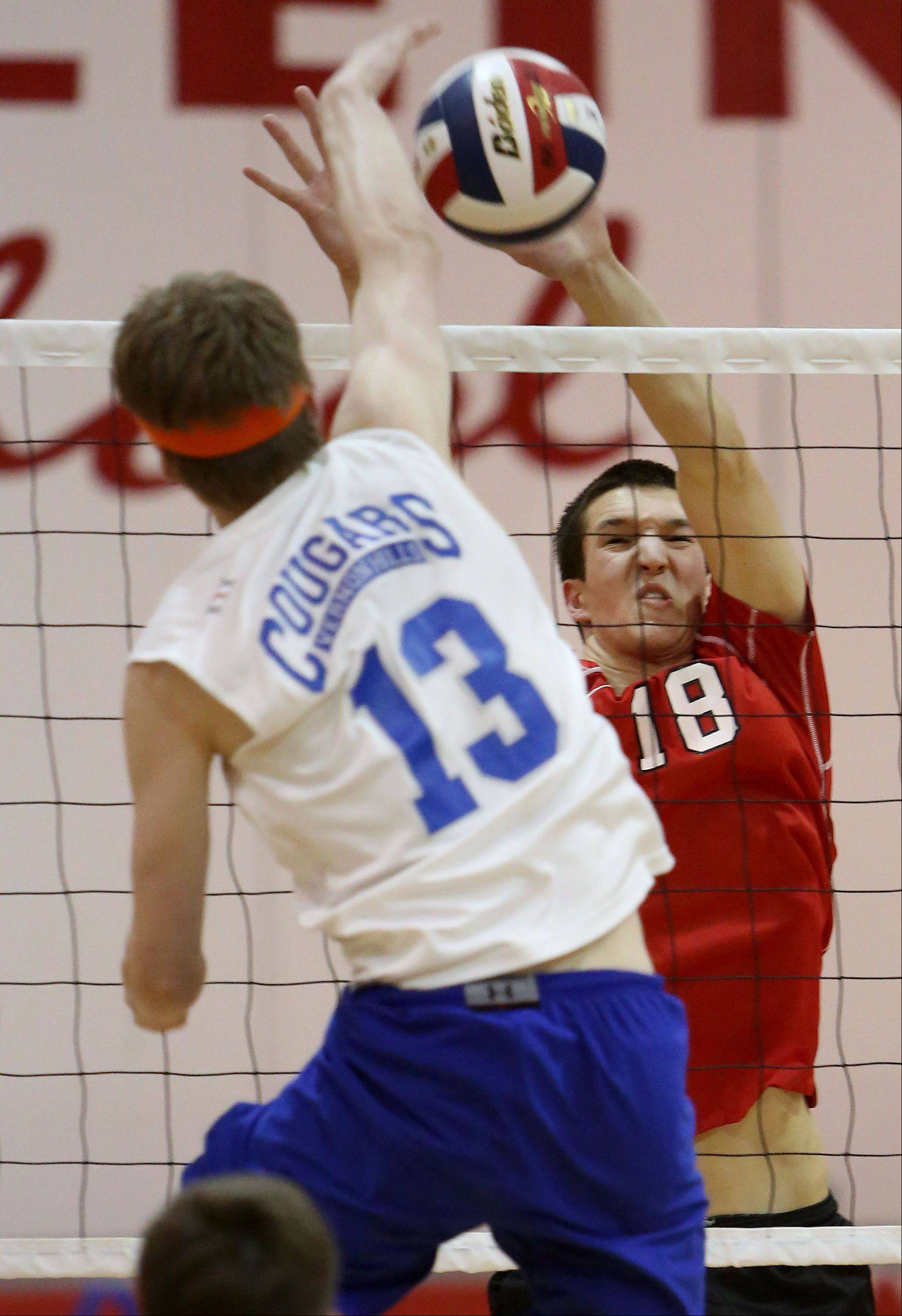Vernon Hills Tyler Small, left, spikes one at Mundelein's Joey Tylka on Wednesday at Mundelein.