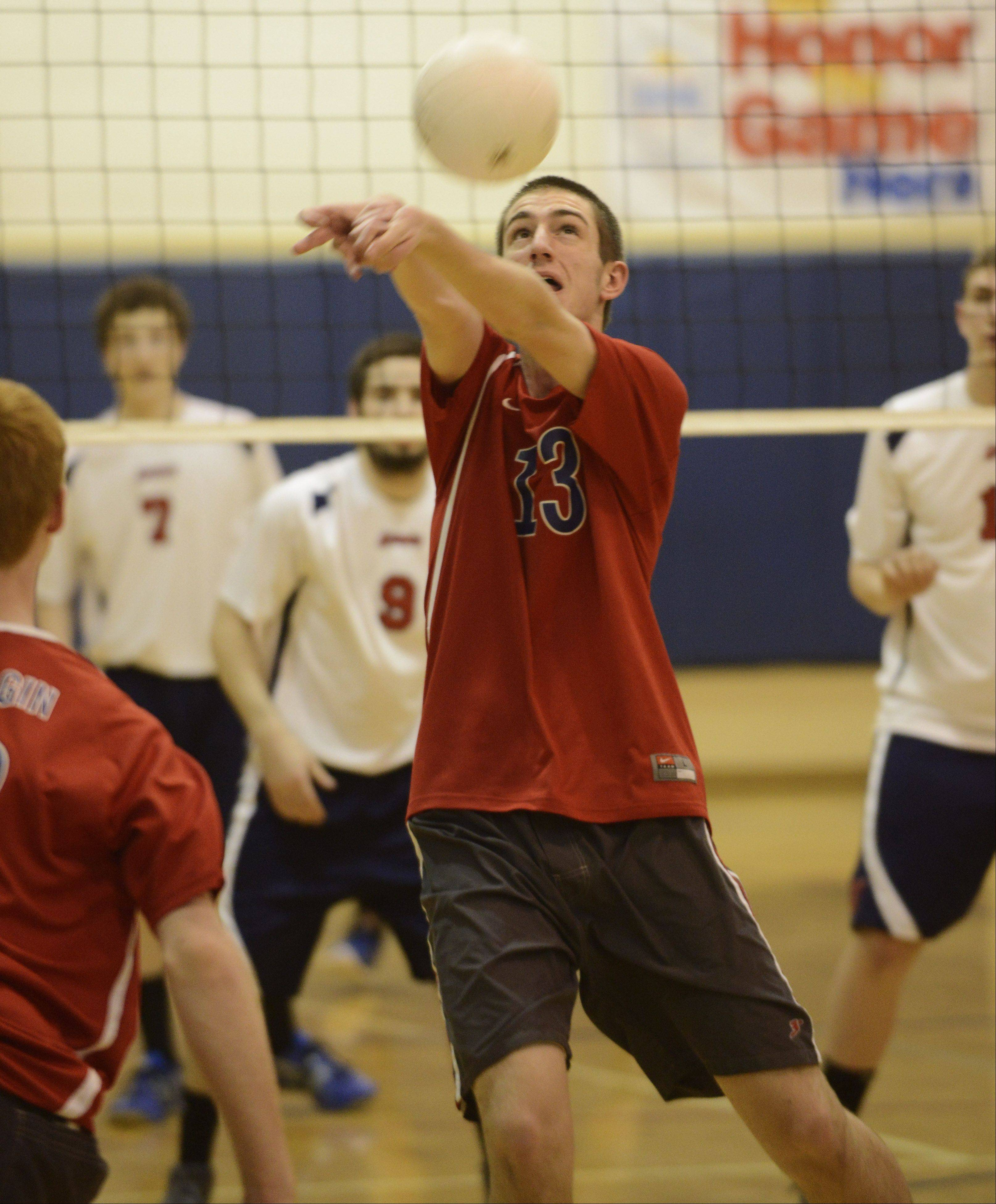 South Elgin's Ian Saxton hustles to keep the ball in play during Wednesday's match against St. Viator.