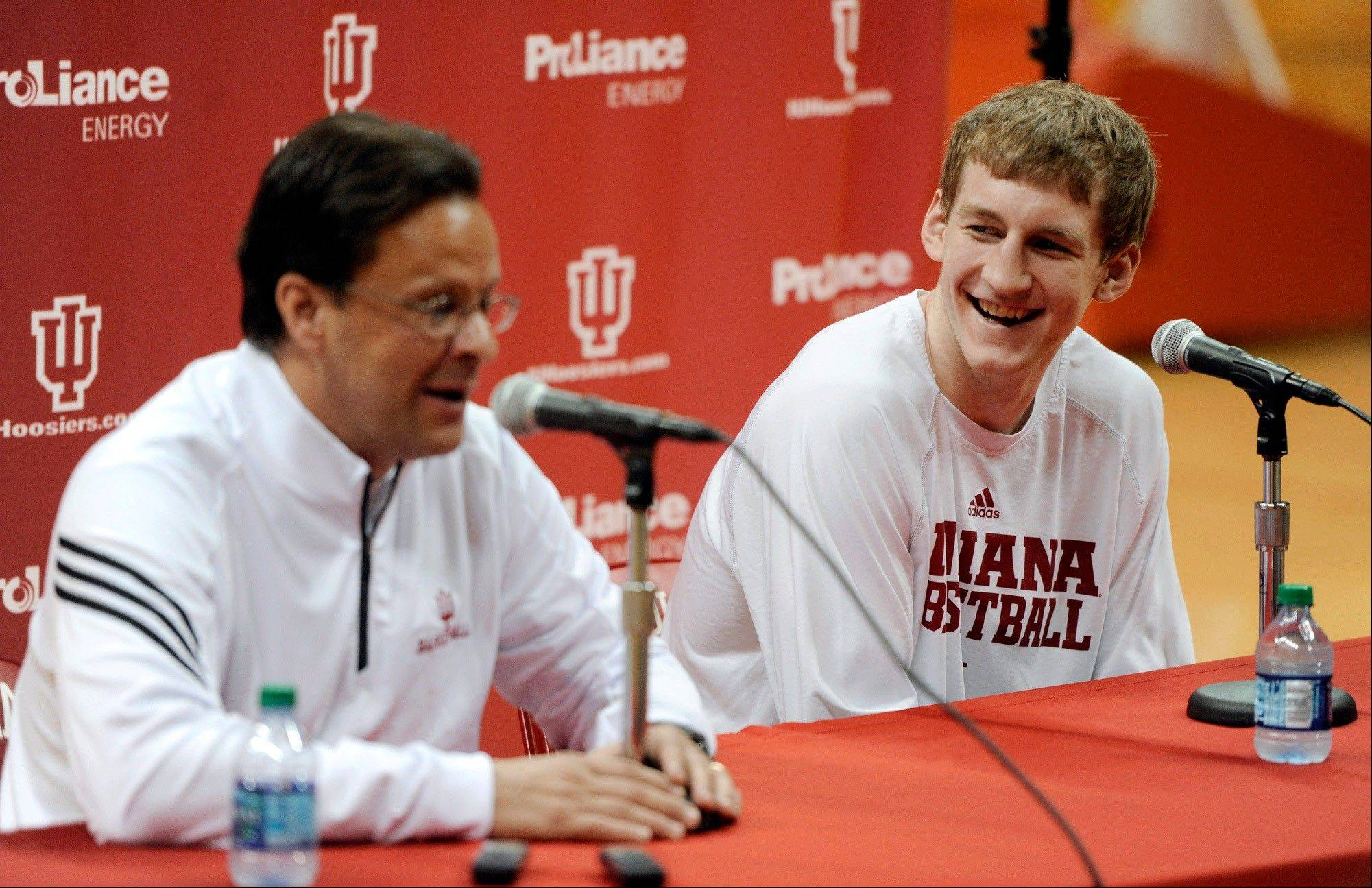 Indiana men's basketball coach Tom Crean speaks as forward Cody Zeller listens during a news conference where Zeller said he will enter the NBA draft, at Assembly Hall in Bloomington, Ind., Wednesday, April 10, 2013.