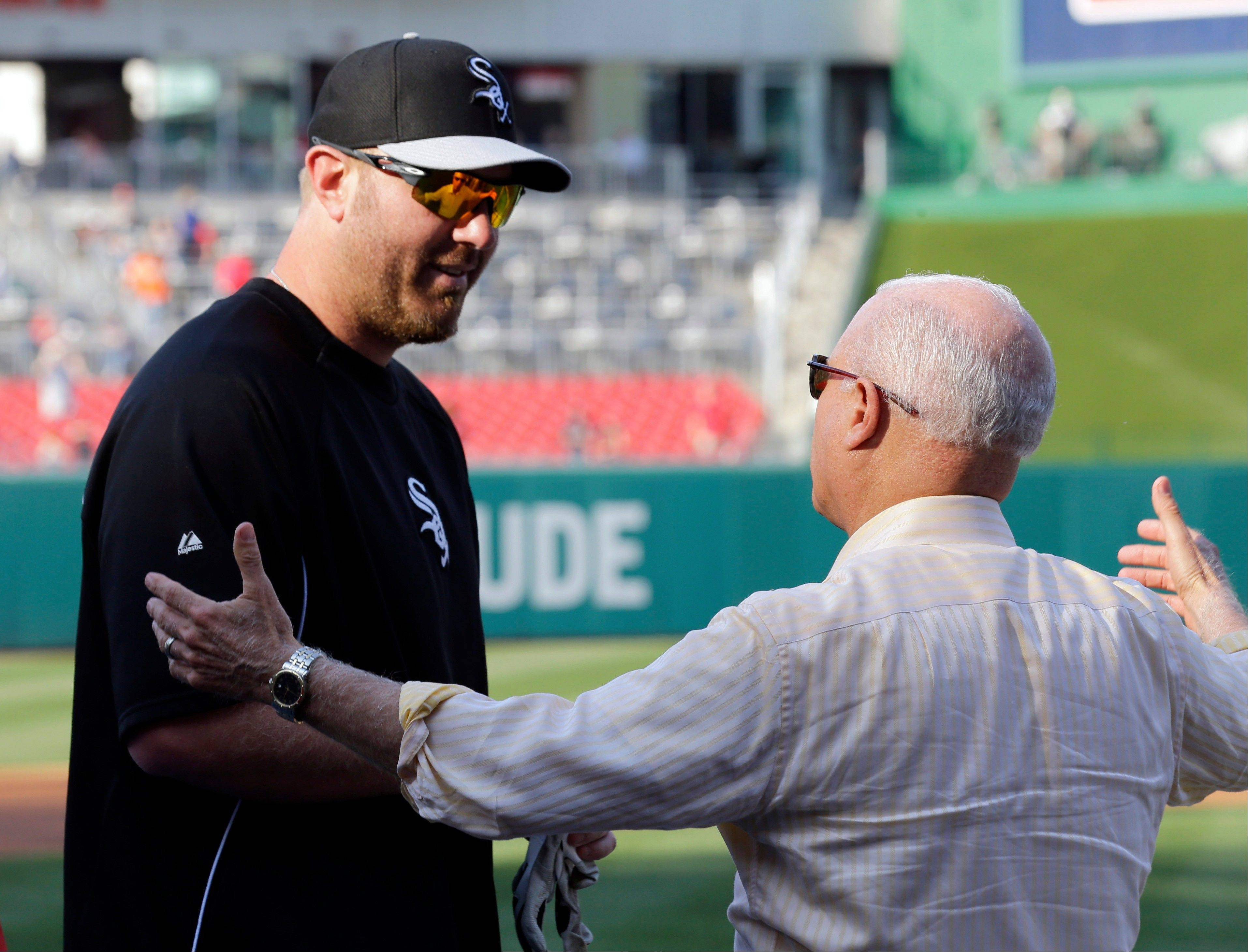 Chicago White Sox designated hitter Adam Dunn, here greeted by Washington Nationals principal owner Mark Lerner, didn't play in Tuesday's game but is expected to be in the lineup for Game 2 of the interleague series.