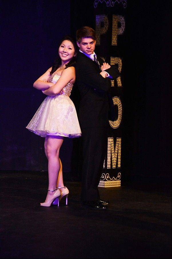 Sophomore Marie Yoo and her escort Matt Briars pose on the stage for the Fremd Prom Fashion Show.