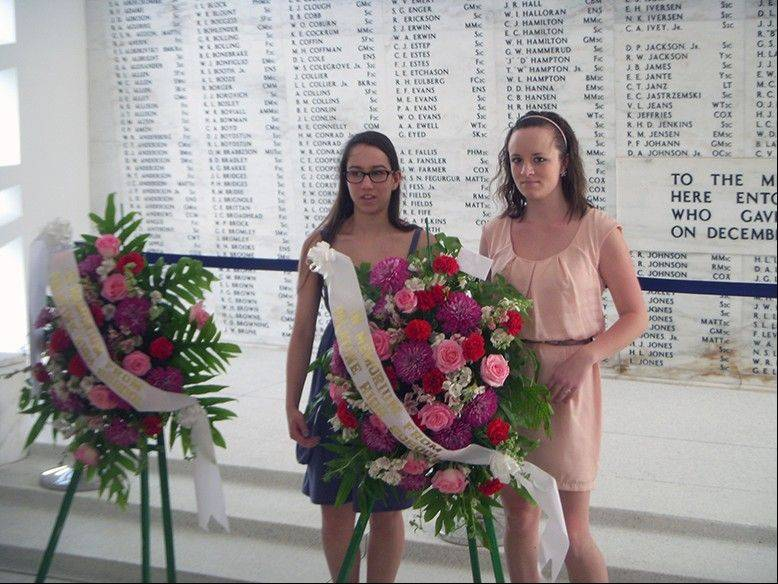 During the school choir's spring break trip to Hawaii, Palatine High School students Colleen O' Mahoney and Katie Beach stand by wreaths presented on behalf of the school to honor those who lost their lives at Pearl Harbor.