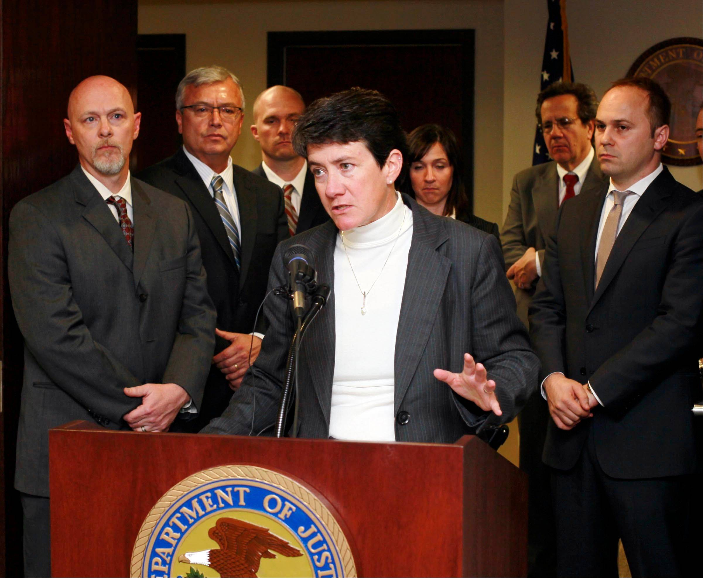 Associated Press U.S. Attorney Wendy J. Olsen announces the indictment by a federal grand jury of four DBSI principal businessmen for conspiracy to commit securities fraud among other charges in a news conference Wednesday in Boise, Idaho.