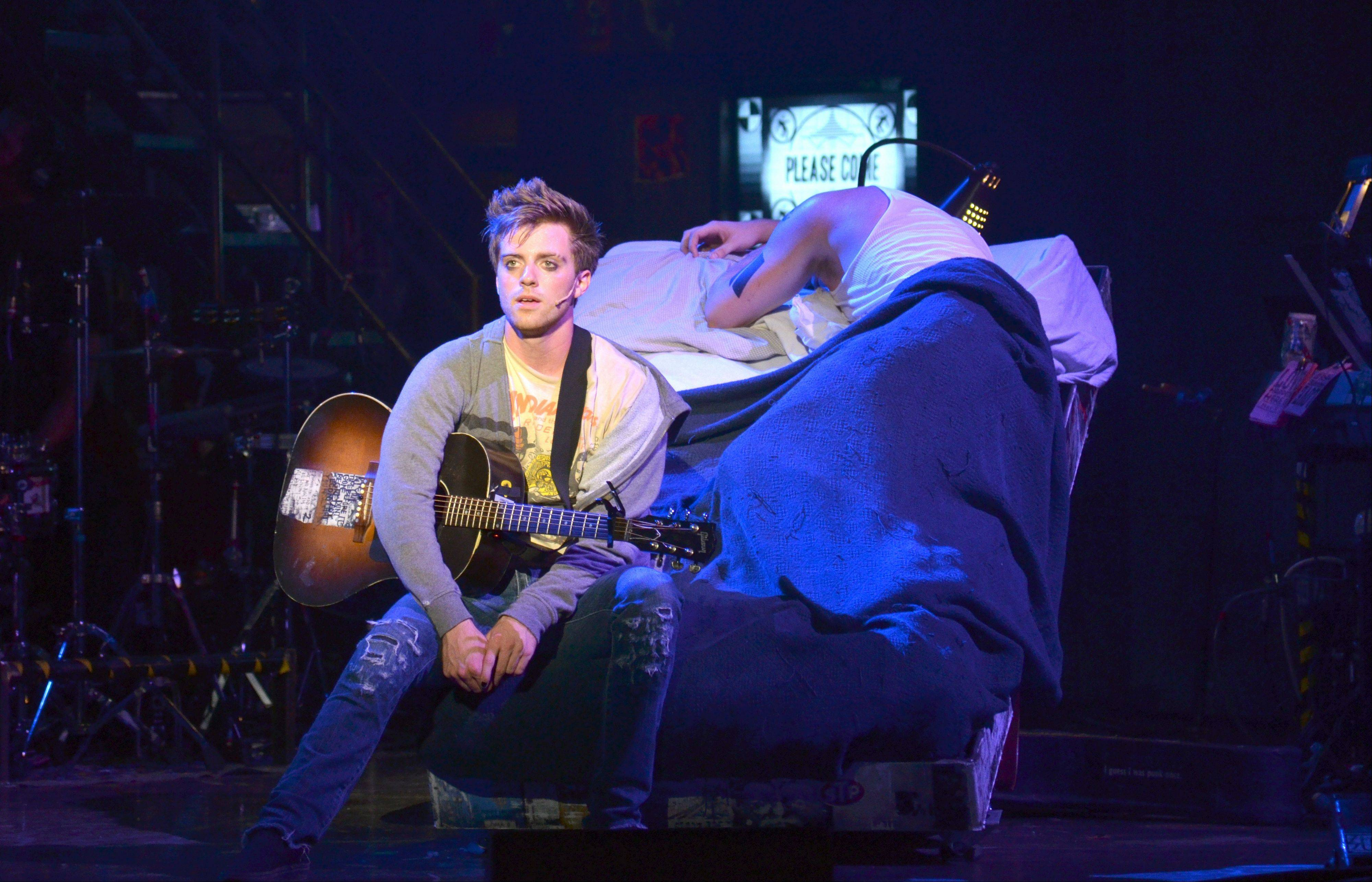 "Northwestern University student Alex Nee, left, plays Johnny in the national tour of ""American Idiot,"" which returns to Chicago at the Cadillac Palace Theatre from Tuesday, April 16, through Sunday, April 21."