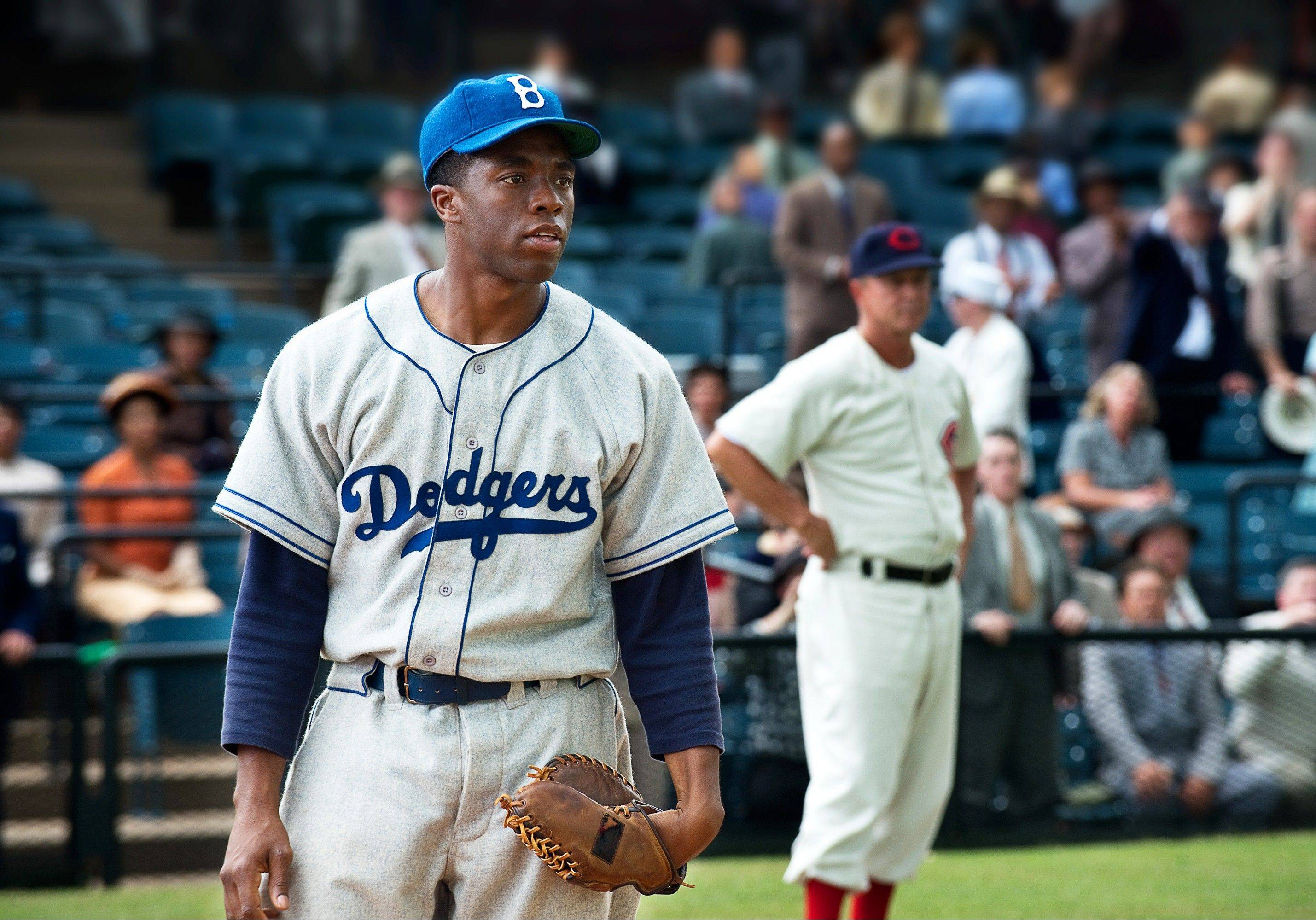 "Jackie Robinson (Chadwick Boseman) faces racism on the field and off in ""42."""