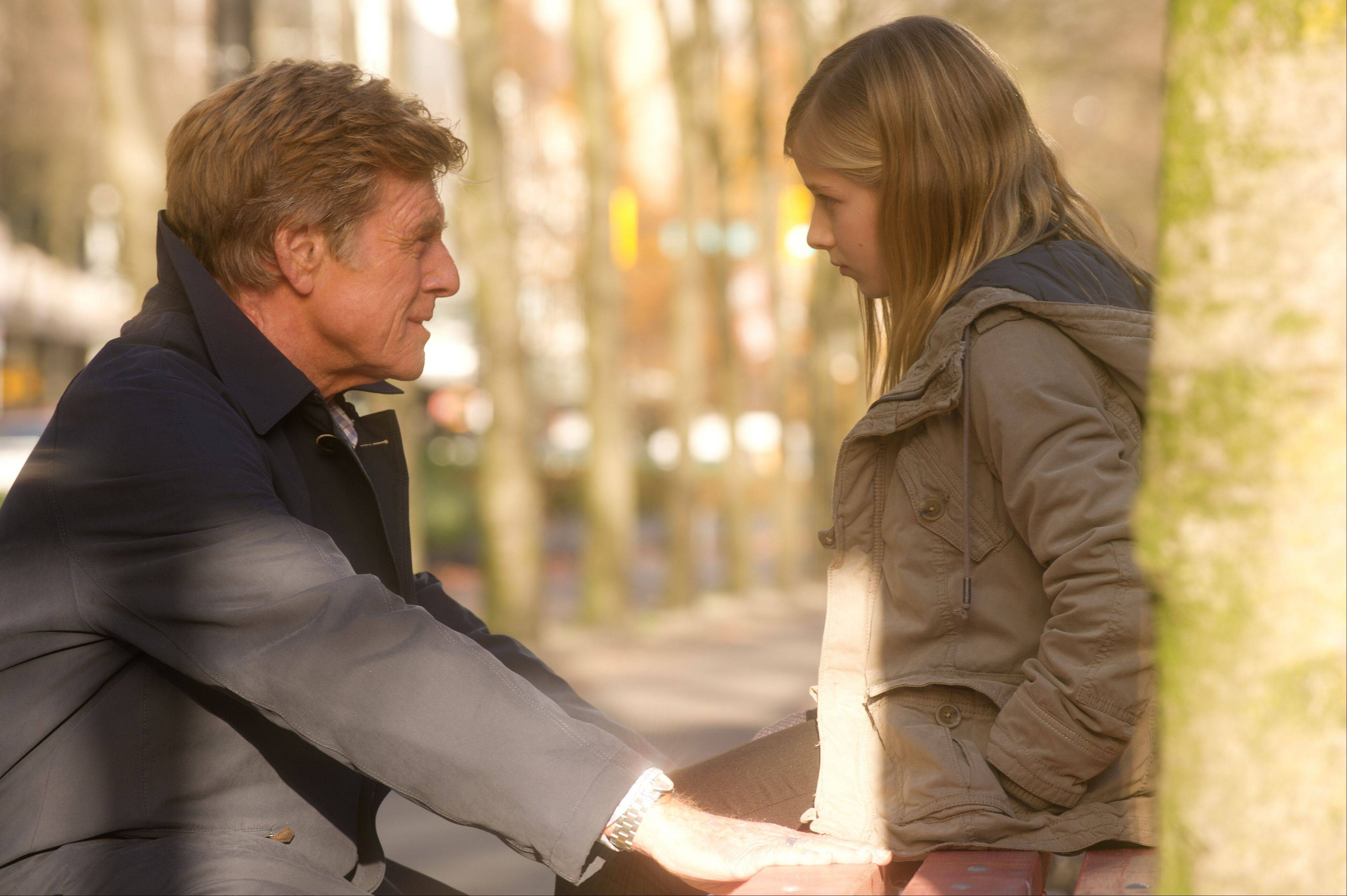 "Civil rights attorney Jim Grant (director Robert Redford) comforts his daughter (Jackie Evancho) just before he goes on the lam in ""The Company You Keep."""