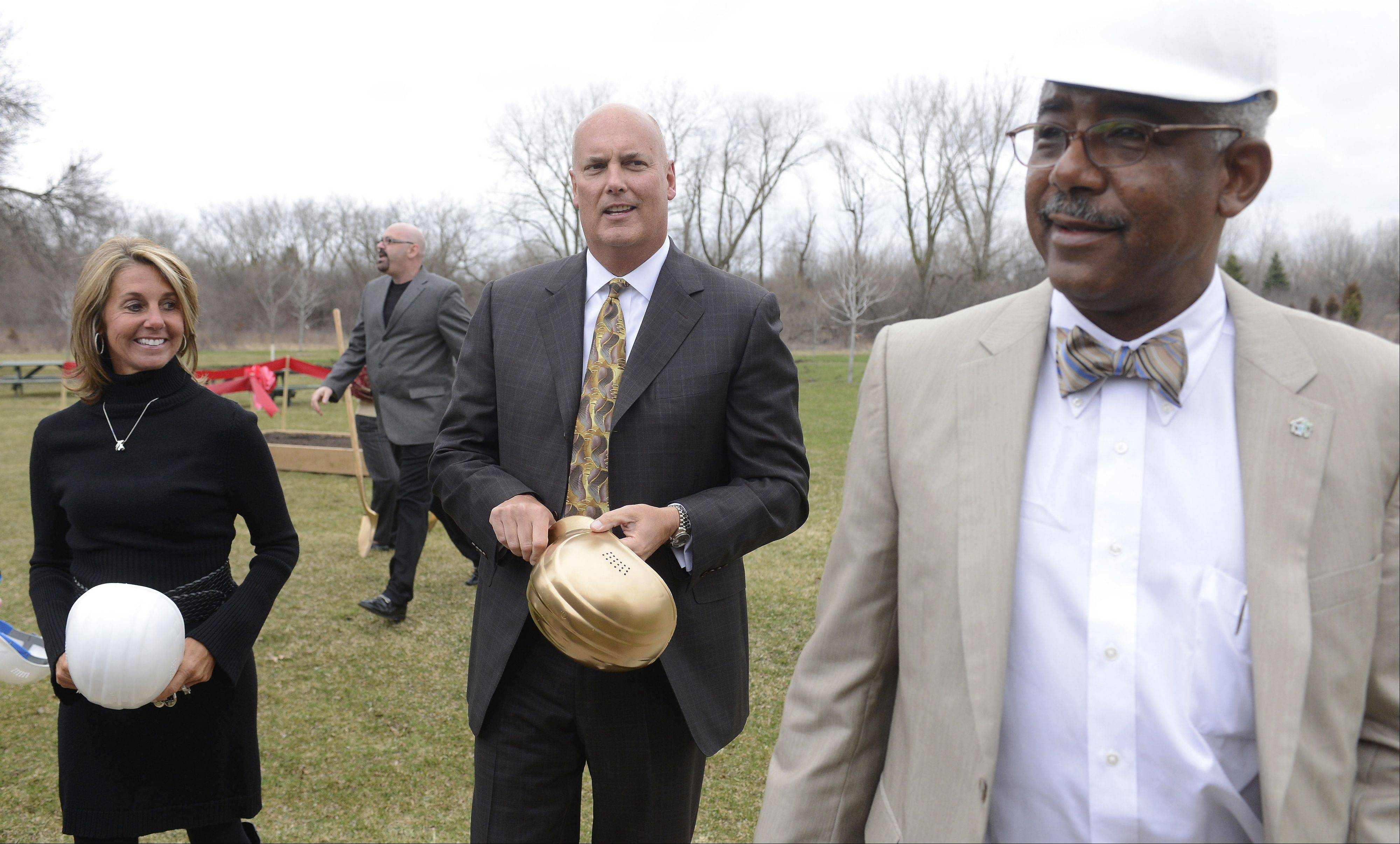 Little City Executive Director Shawn Jeffers, right, walks with Becky and John Duffey of Long Grove following the groundbreaking Friday afternoon.
