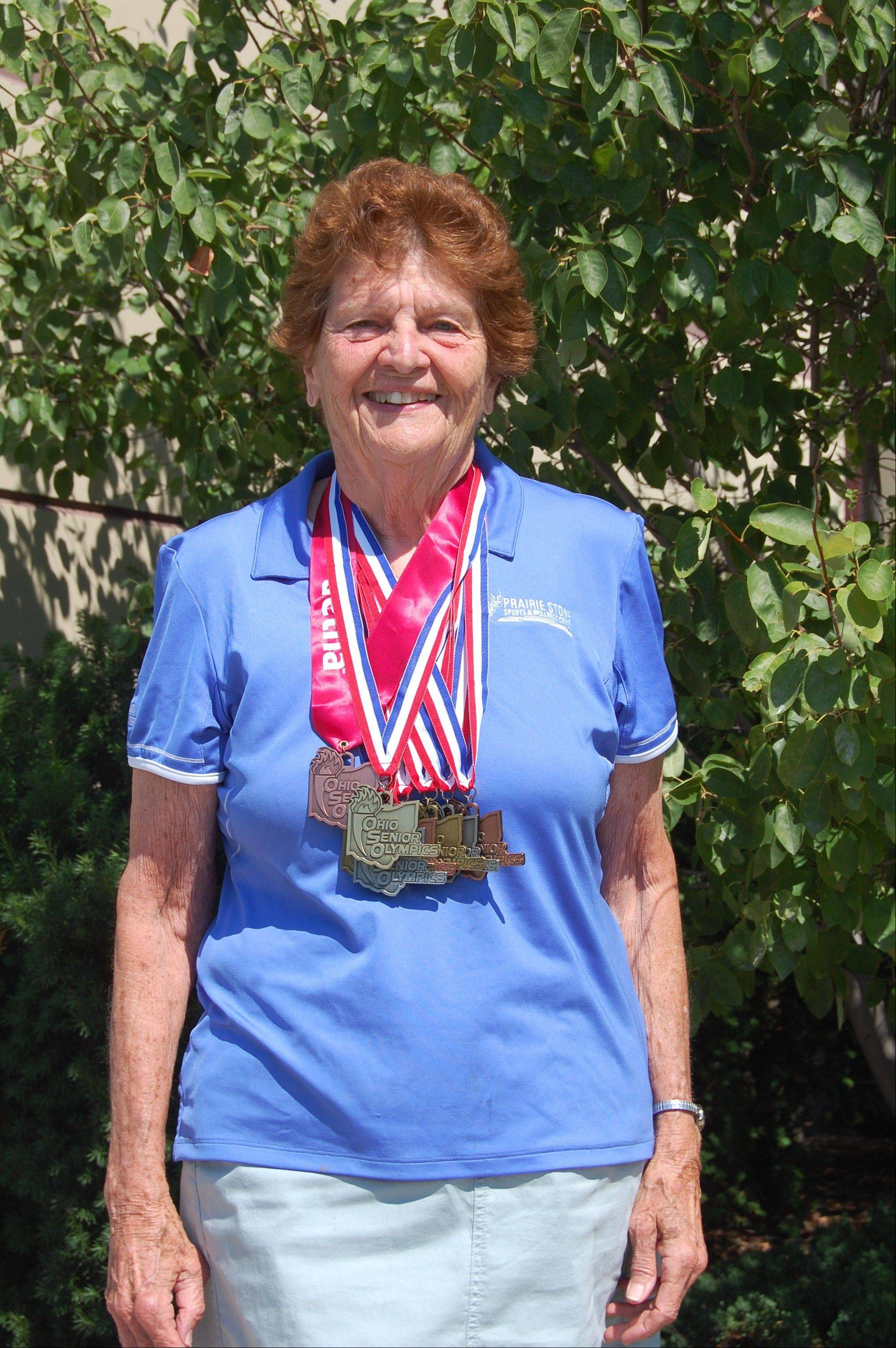 Lollie Guiney, a Hoffman Estates Park District board commissioner, won eight medals in the Senior Olympics in July 2012. She is stepping down after 16 years on the board.