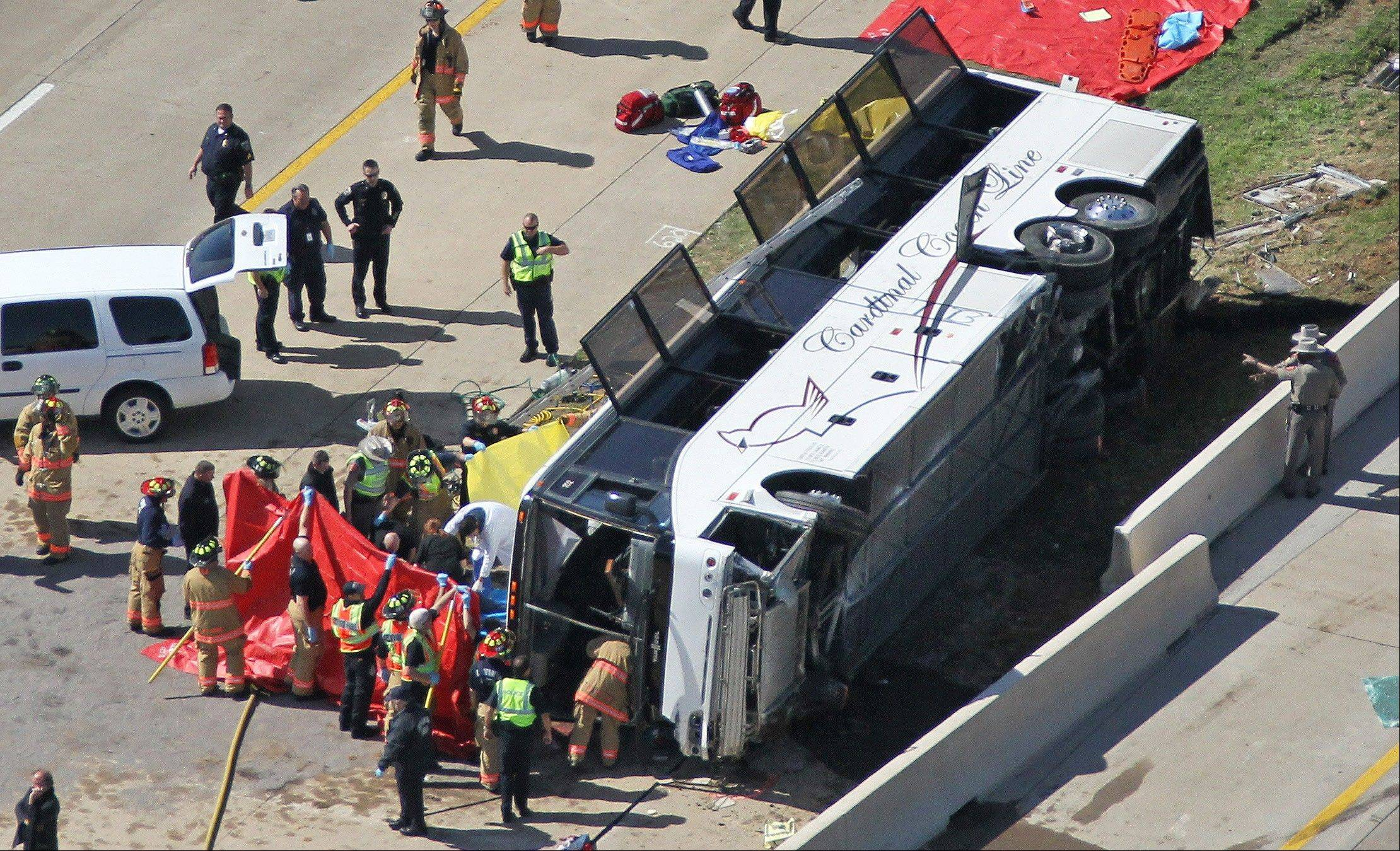 Rescue personnel work the scene of a Cardinal Coach Line charter bus accident in Irving, Texas, Thursday. Authorities said at least two people were dead and more than 40 others were hospitalized after the chartered bus overturned.
