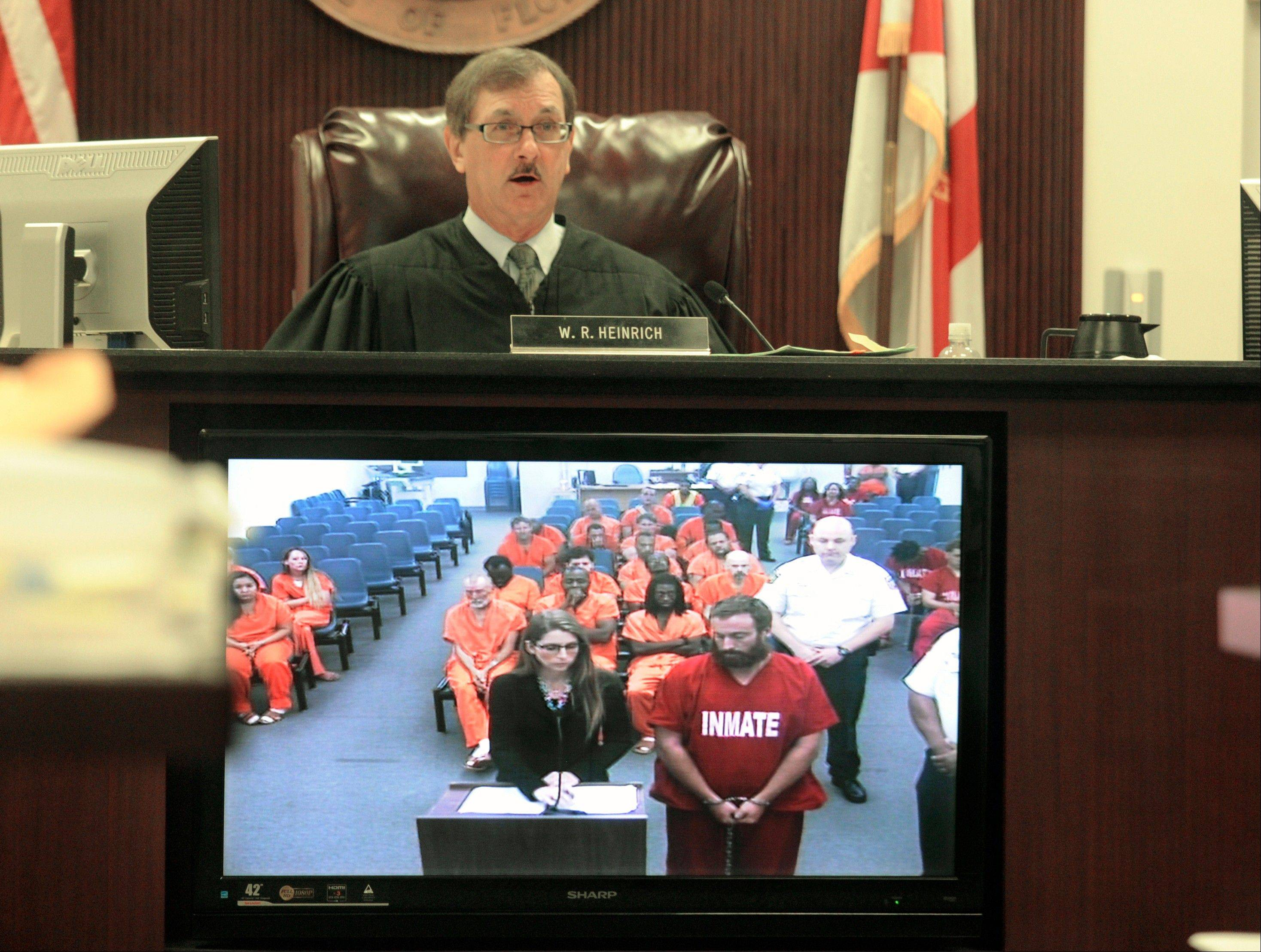 Joshua Hakken appears, via video feed from jail, in front of Judge Walter Heinrich, Thursday April 11, 2013, in Tampa, Florida. He and his wife Sharyn Hakken face charges related the kidnapping of their two children from their grandmother and fleeing to Cuba after losing custody. They were ordered Thursday to remain in jail without bond and to have no contact with their two young sons.