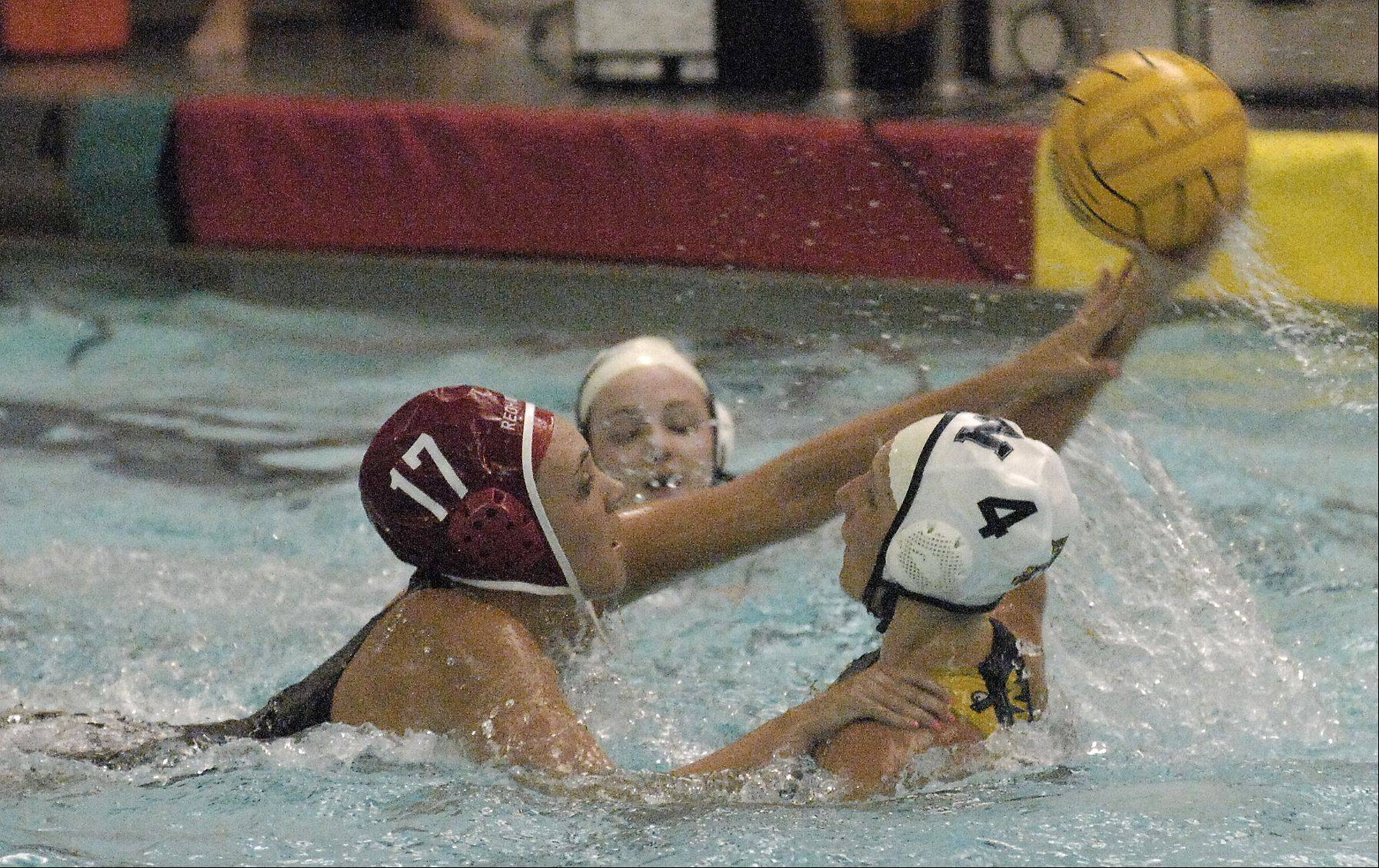 Michelle Spaits of Naperville Central and Morgan Miller of Neuqua Valley battle for control of the ball during varsity girls water polo at Central, Thursday.