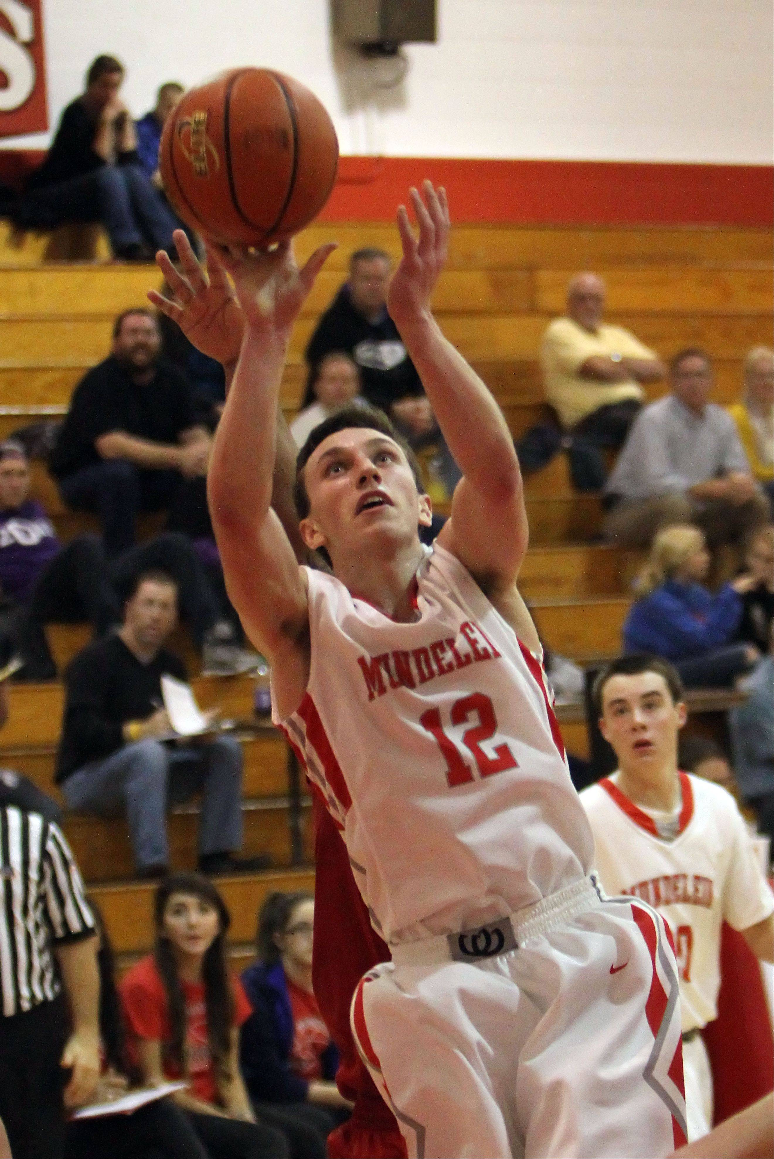 Mundelein�s Quinn Pokora drives to the hoop against Lakes last season at Mundelein.