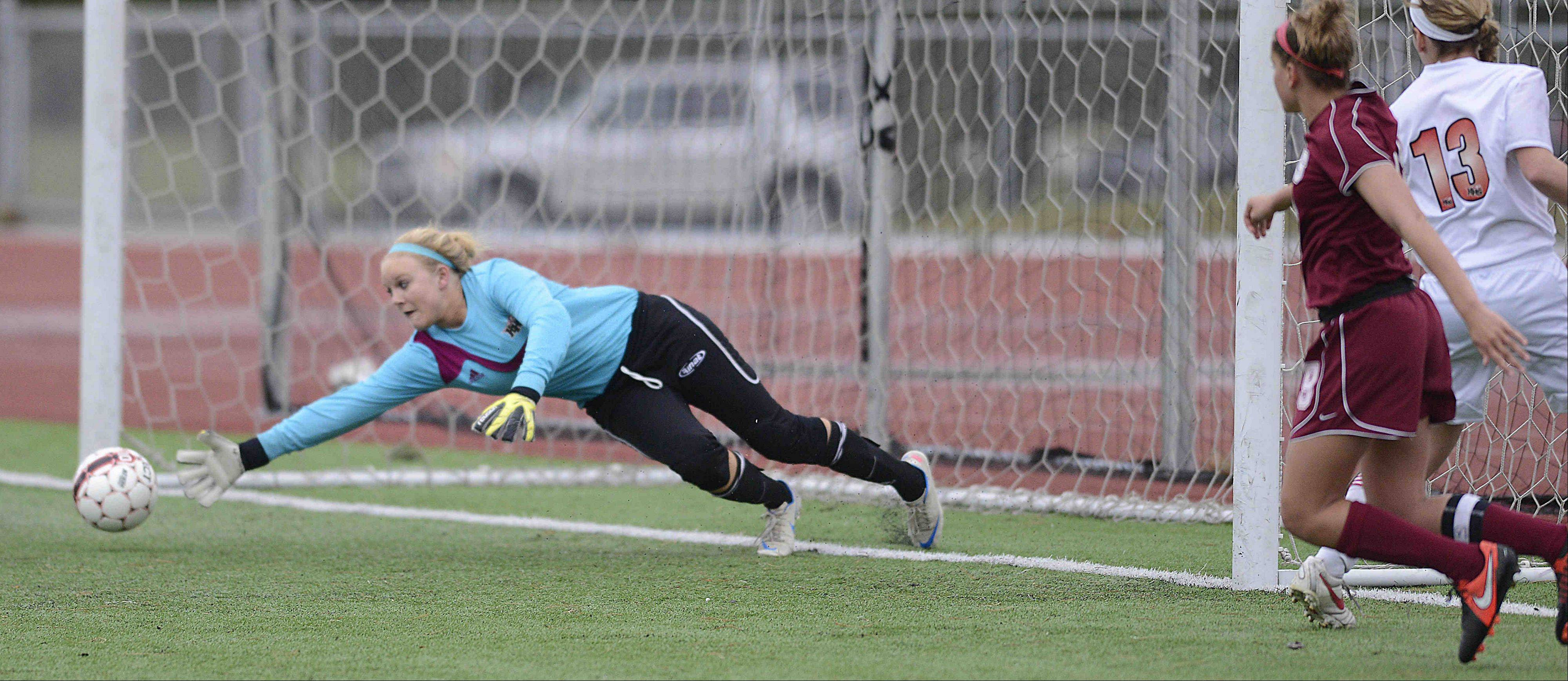 Huntley goalkeeper Jessica Galason dives for a shot that goes wide from Plainfield North�s Shayna Dheel Thursday in the Pepsi Showdown quarterfinal game at Northern Illinois University in DeKalb.