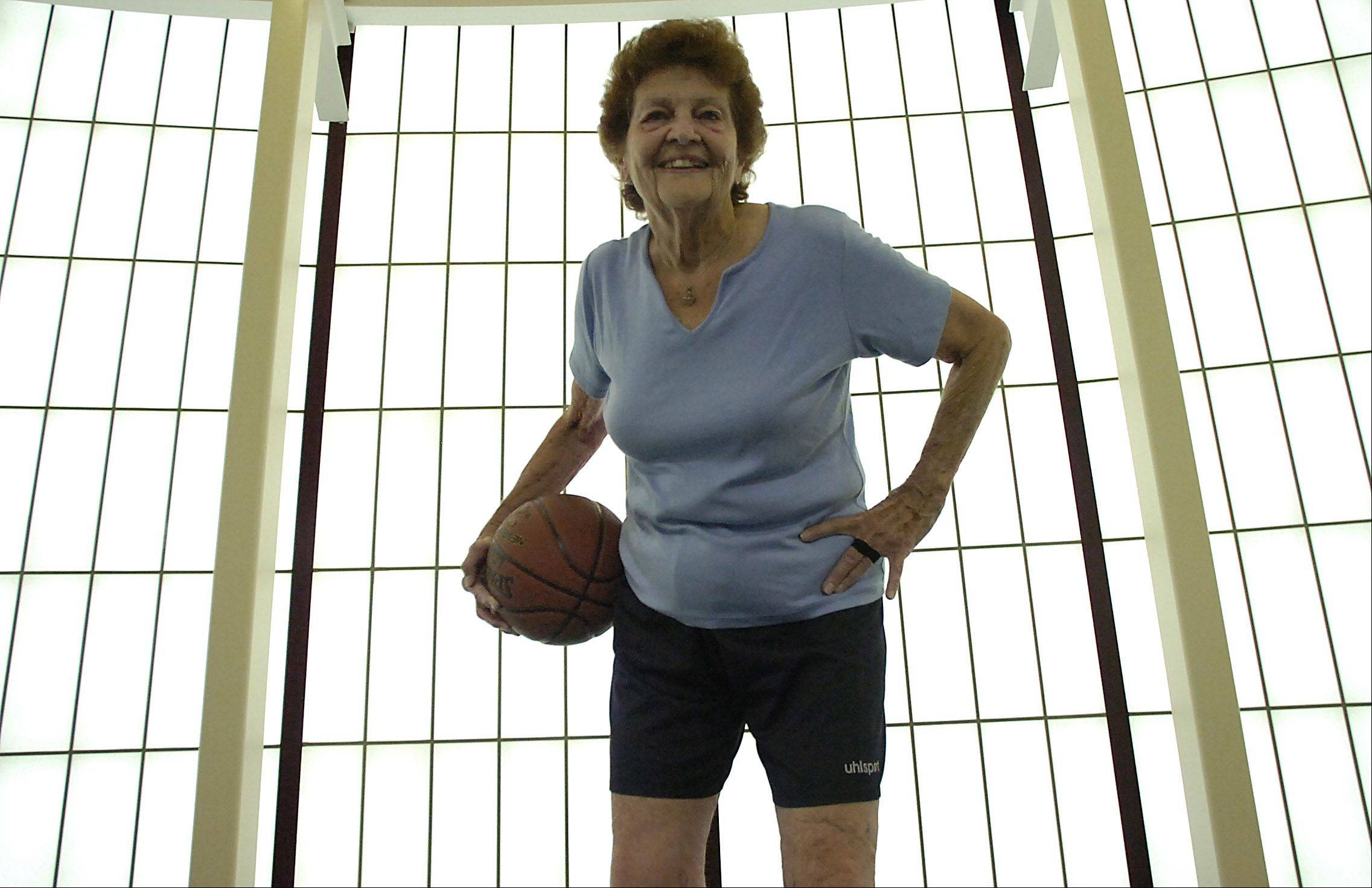 Lollie Guiney shoots hoops at the Hoffman Estates Park District at age 78. She is now 82, and stepping down from her position as commissioner on the park district board after 16 years of service.