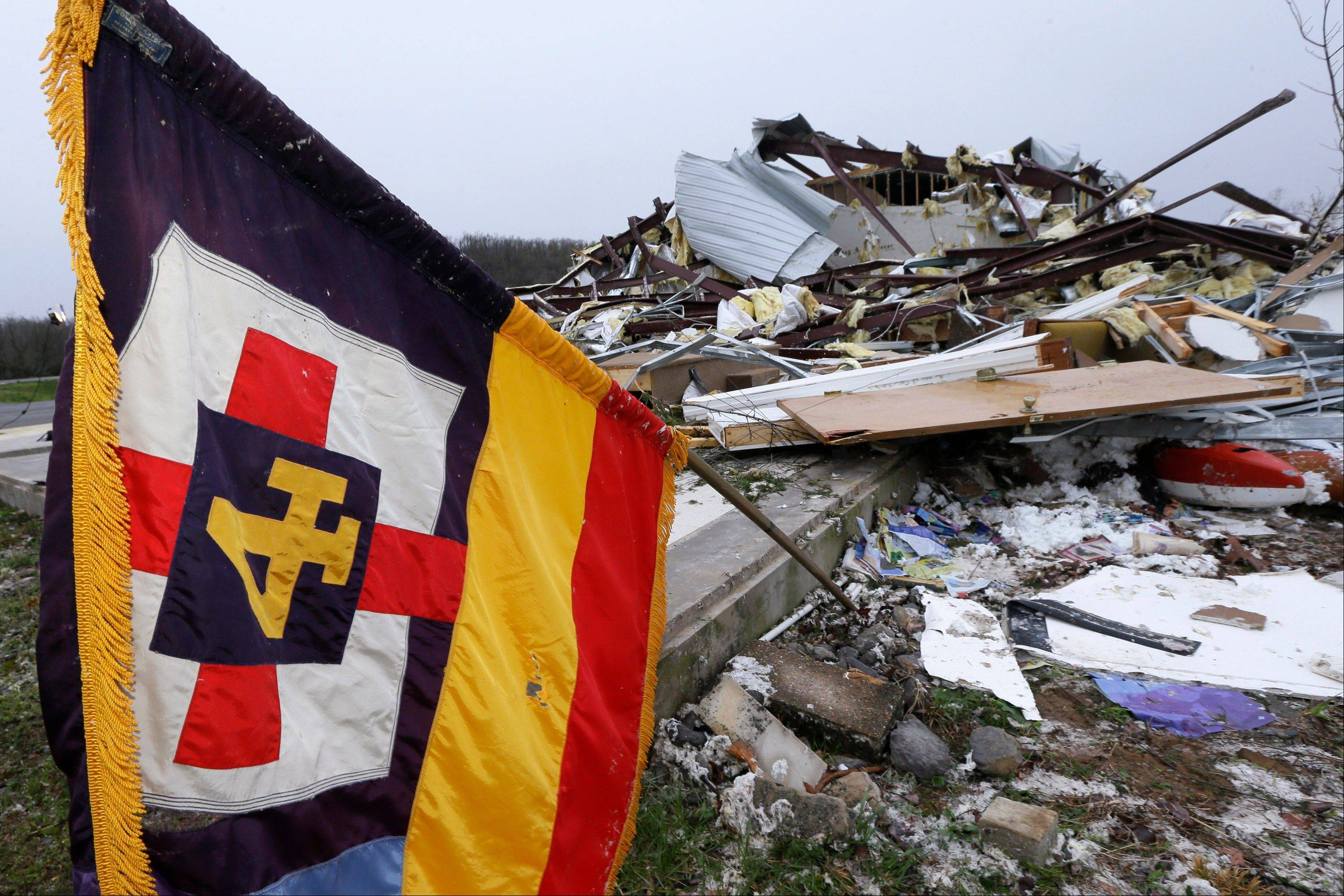 A flag flutters over what remains of the sanctuary of the Botkinburg Foursquare Church in Botkinburg, Ark., Thursday, April 11, 2013 after a severe storm struck the building late Wednesday. The National Weather Service is surveying areas Thursday to determine whether tornadoes or strong winds caused damage.