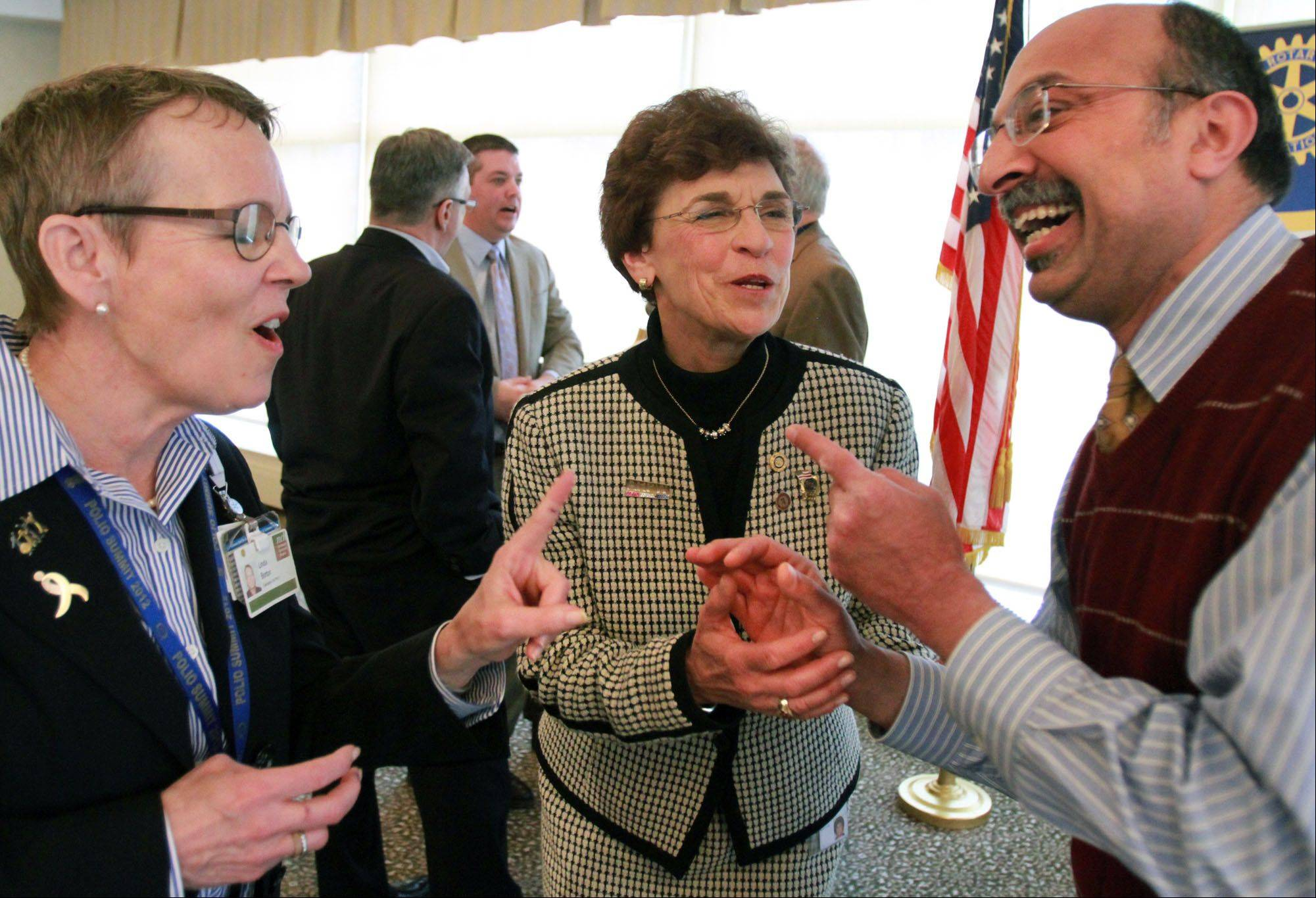 Arlington Heights Mayor Arlene Mulder, center, has a laugh with Linda Borton, Arlington Heights Rotary vice president, left, and Harry Vaswani of Arlington Heights.