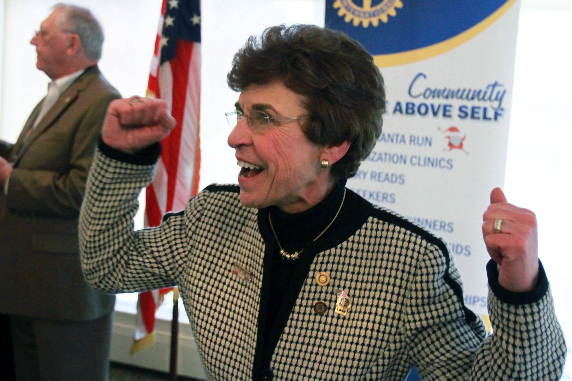 Mayor Arlene Mulder leads a cheer at the Rotary luncheon.